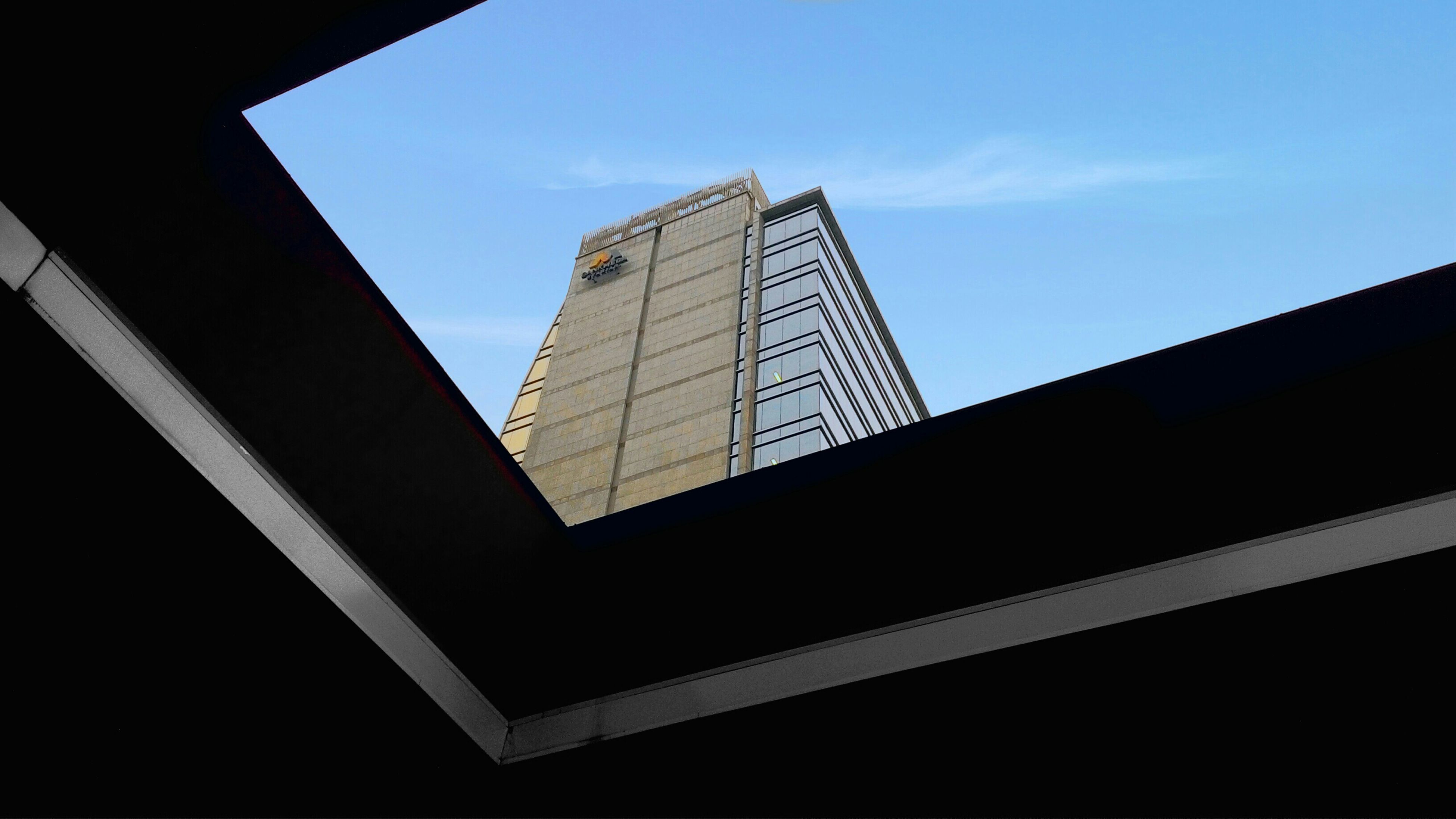 architecture, built structure, building exterior, low angle view, skyscraper, tall - high, modern, tower, office building, city, sky, tall, building, glass - material, reflection, no people, day, capital cities, travel destinations, clear sky