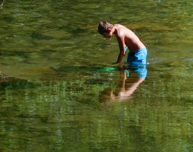 Green Colour In The River Living Nature Mirroring In Water Outdoors Reflection Tranquil Scene Young Boy
