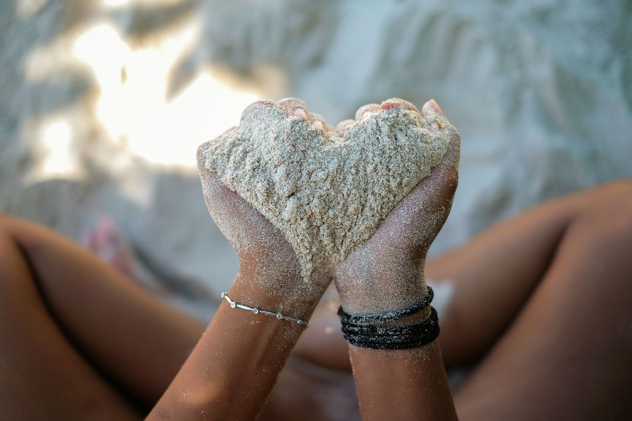 Heart Shape Human Body Part Human Hand One Person Adults Only Only Women One Woman Only People Close-up Outdoors Shiny Adult Day Sky Nature Sands Love Beautifully Organized