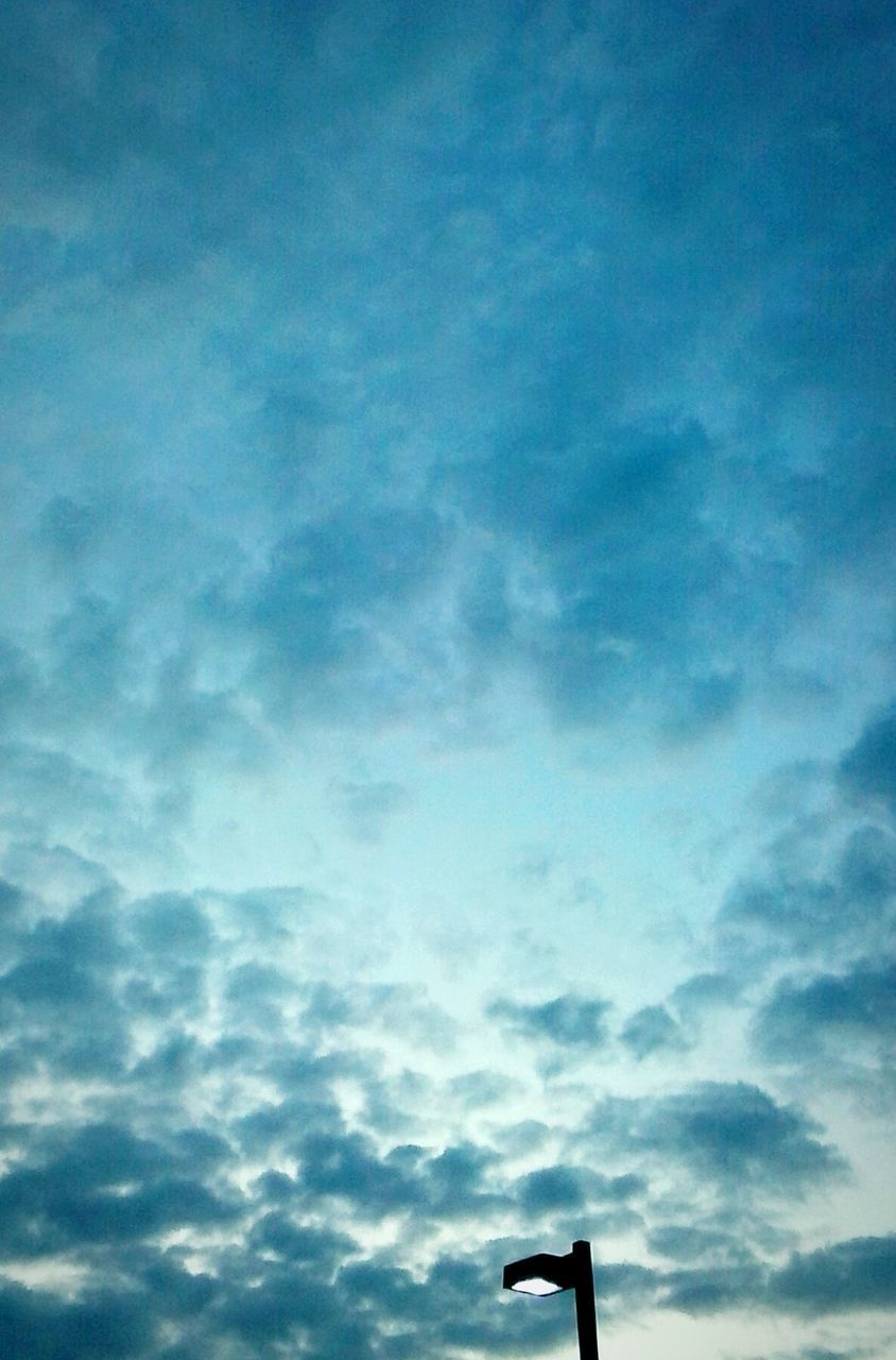 cloud - sky, sky, low angle view, no people, day, outdoors, silhouette, nature, blue, road sign, beauty in nature, storm cloud