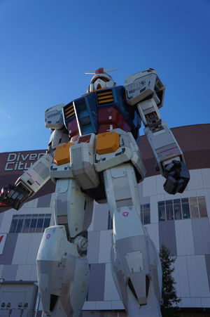 The Giant Gundam Gundam Gundam Model Japan Architecture Blue Building Exterior City Clear Sky Close-up Day Gundamcollection Hanging Japan Toys Low Angle View No People Outdoors Sky