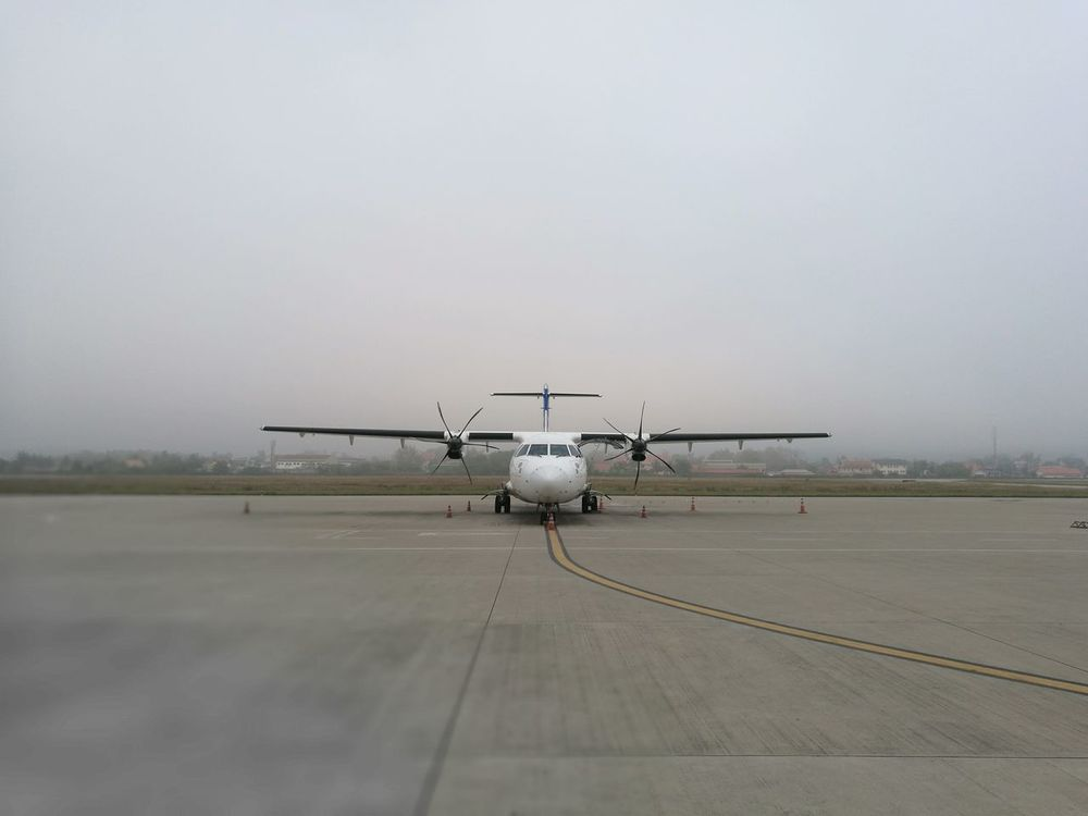 waiting Airplane Airport Runway Louangphabang Destination Airport Fog No People Air Vehicle Outdoors Day Mornings Waiting Gray Gray Day Mist Alone