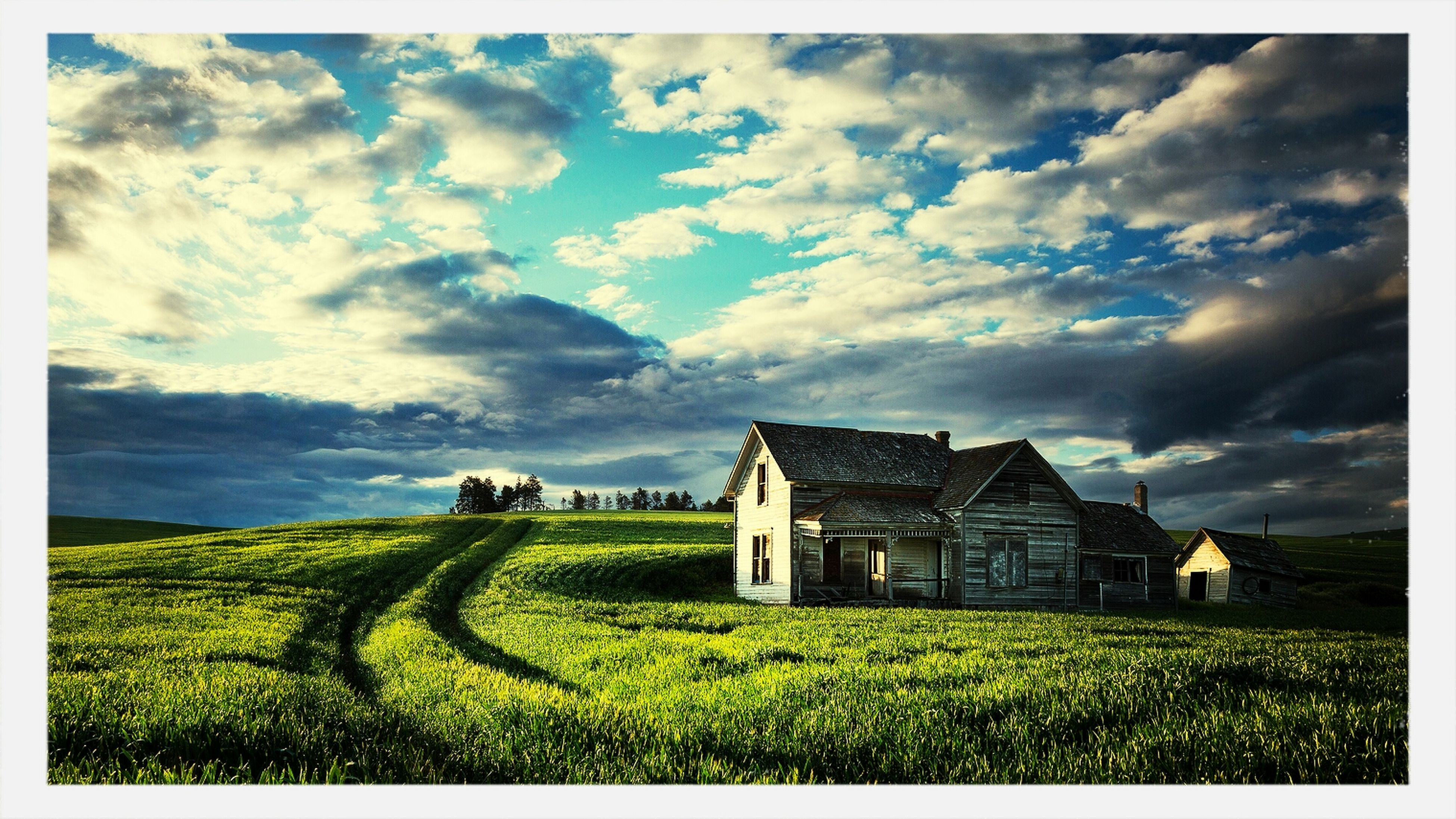 field, rural scene, sky, grass, agriculture, building exterior, architecture, landscape, built structure, farm, cloud - sky, house, cloud, crop, tranquil scene, growth, grassy, nature, cloudy, beauty in nature