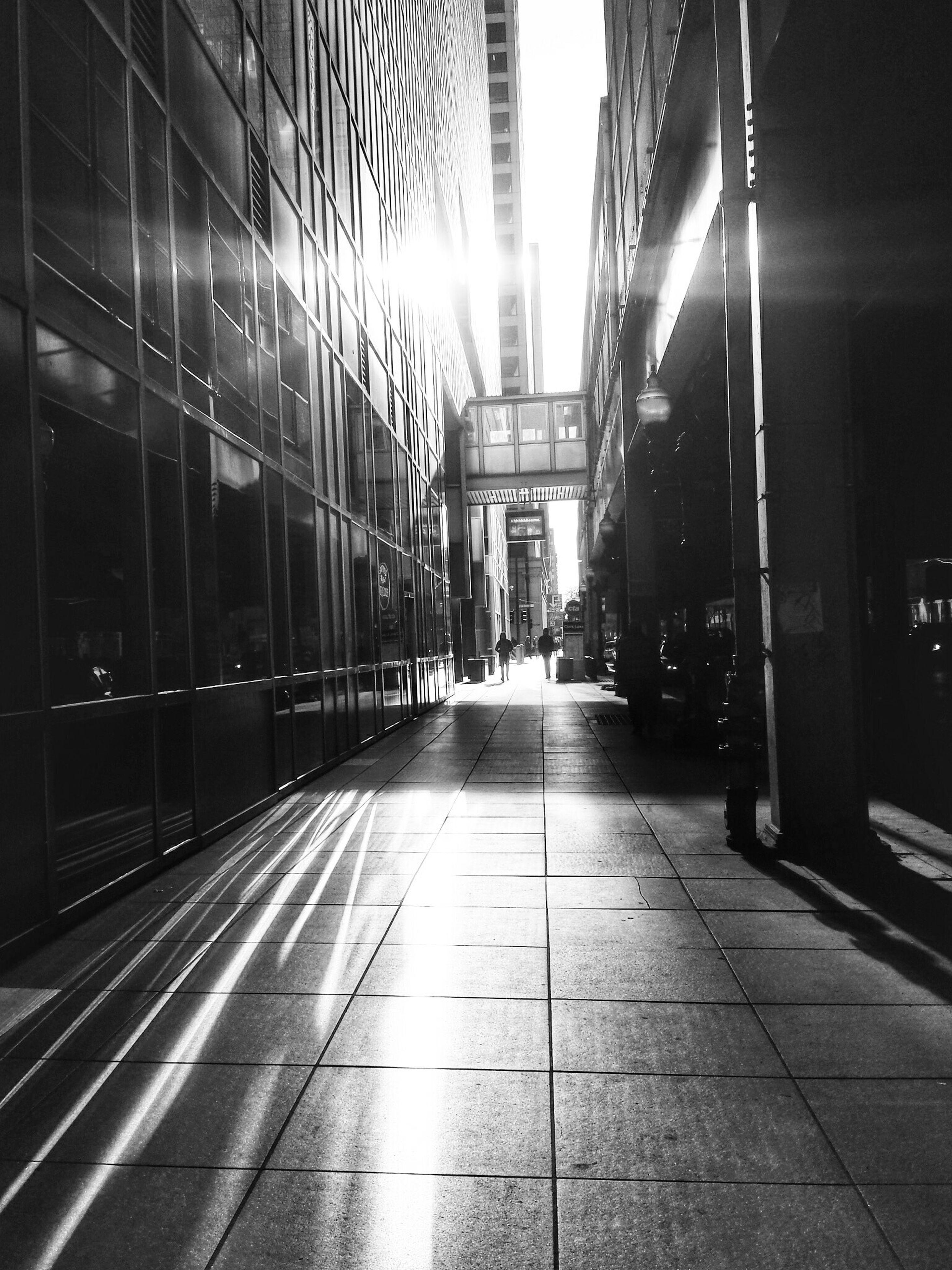 architecture, built structure, the way forward, building exterior, illuminated, diminishing perspective, city, empty, building, incidental people, vanishing point, transportation, street, city life, narrow, long, lighting equipment, night, walkway, corridor