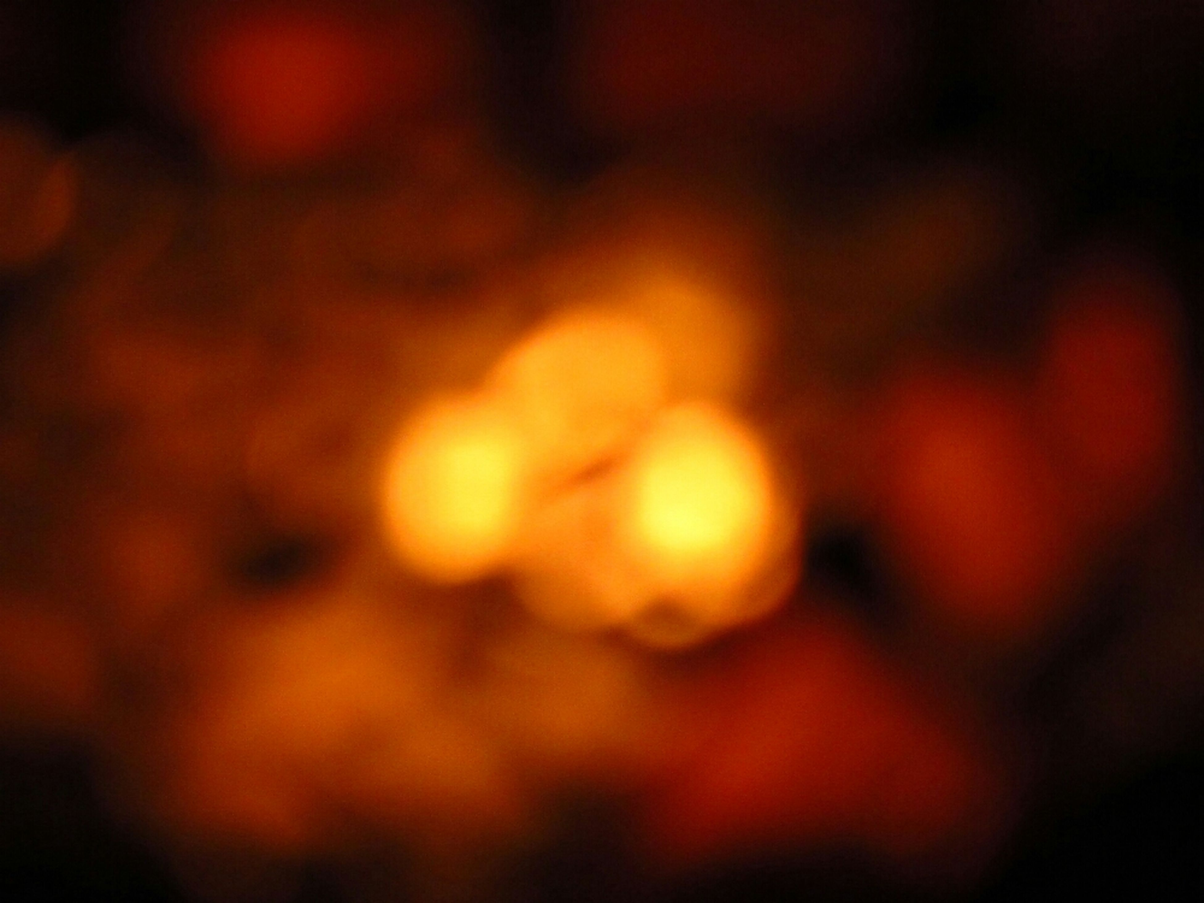 night, illuminated, defocused, glowing, selective focus, close-up, dark, light - natural phenomenon, focus on foreground, orange color, no people, backgrounds, outdoors, nature, lighting equipment, full frame, beauty in nature, light, abstract, tranquility