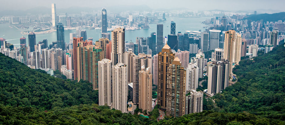 Victoria Peak, Hong Kong Aerial View Architecture Blue Buildings Business Finance And Industry City Cityscape Finance Finance And Economy Green Hong Kong Igniting Modern Mountain Peak Panoramic Skyscraper Tourism Towers Tranquility Travel Travel Travel Destinations Urban Skyline Victoria Peak Victoria Peak, Hongkong
