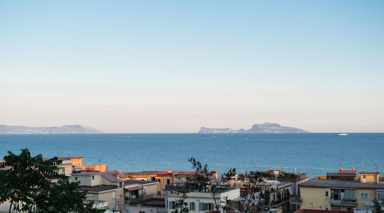 Capri island seen from Pozzuoli at sunset Architecture Building Exterior Capri Horizon Over Water Outdoors Panorama Pozzuoli Sea Sky Sunset