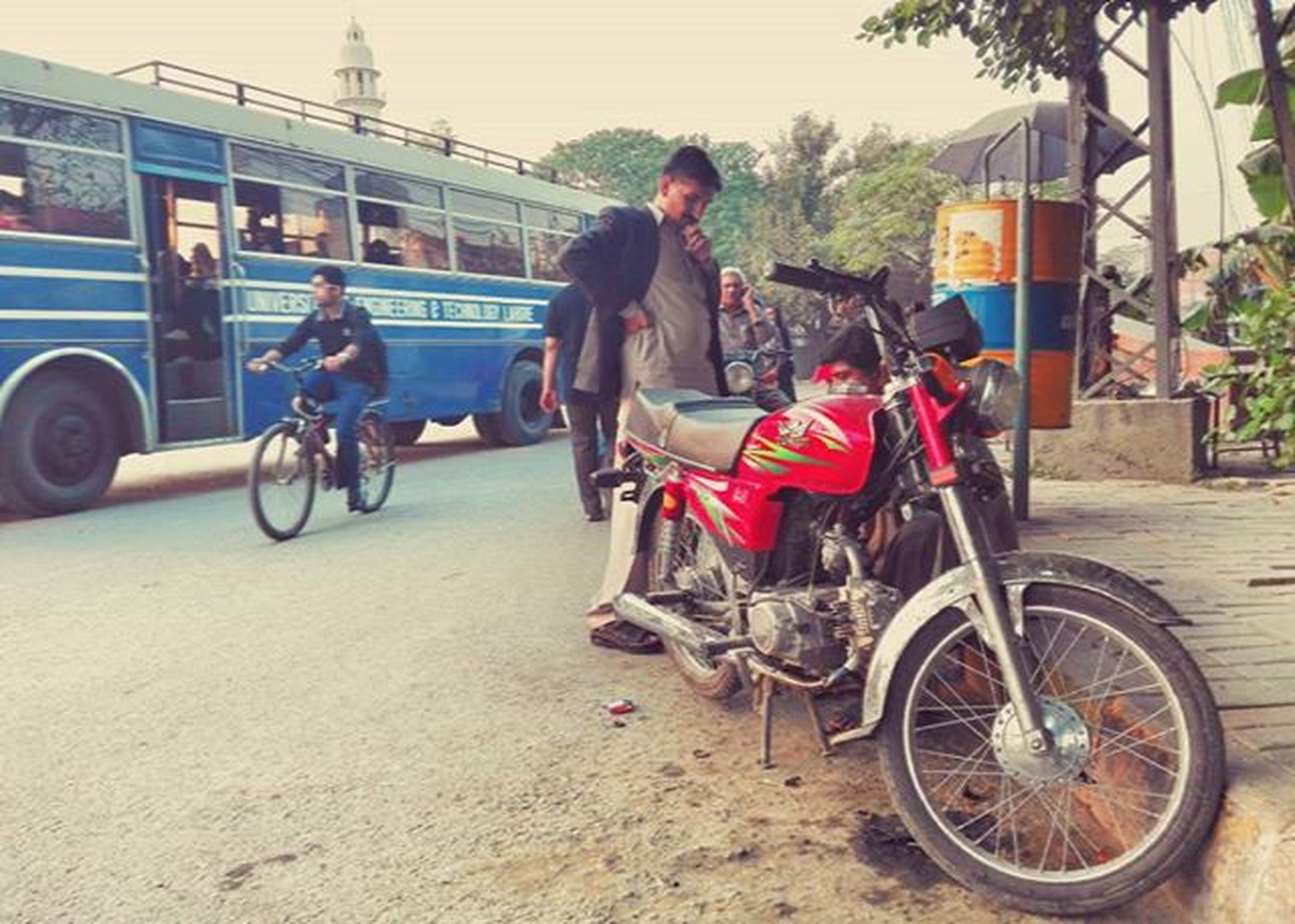 mode of transport, transportation, land vehicle, bicycle, lifestyles, riding, leisure activity, men, full length, casual clothing, travel, street, stationary, car, motorcycle, side view, togetherness