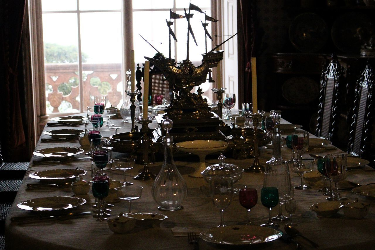 Antique Antiques Arrangement Chair Close-up Dark Day Decoration Dining Table Drinking Glass Exceptional Photographs Glass Glass - Material Glasses Indoors  Interior Design No People Plate Plates Setting The Table Table Table Setting Vintage Window Wineglass