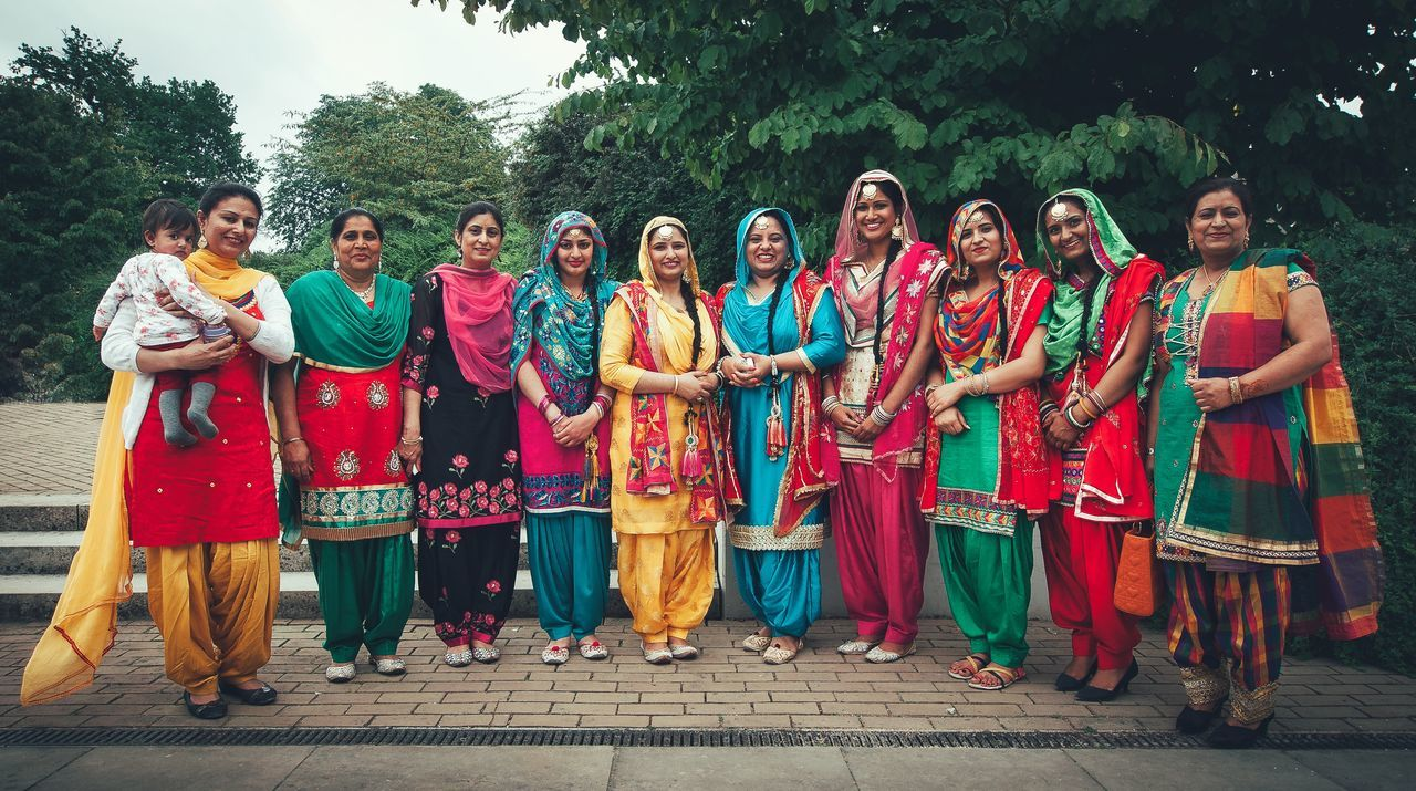 lifestyles, women, dancing, real people, cultures, large group of people, full length, tree, outdoors, celebration, traditional clothing, people, men, adult, performance, period costume, day