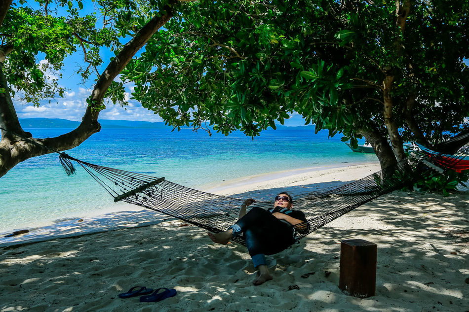 Adult Adults Only Beach Beauty In Nature Day EyeEm Gallery Full Length Hammock Men Nature One Person Only Women Outdoors People Relax Relaxing Scenics Sea Sitting Sky Tree Water Islands