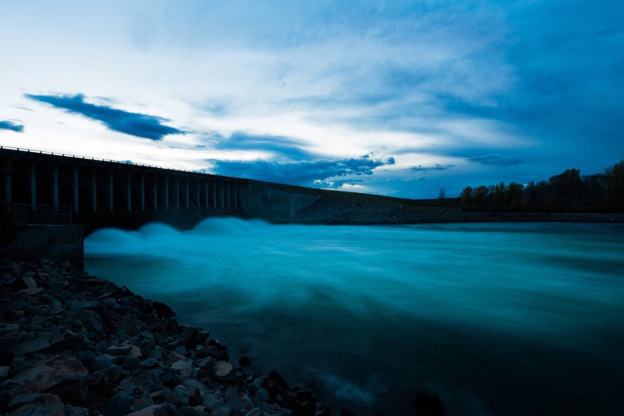 dam, water, hydroelectric power, river, built structure, bridge - man made structure, nature, outdoors, sky, architecture, beauty in nature, fuel and power generation, scenics, long exposure, no people, cloud - sky, day, travel destinations, industry, waterfall, tree