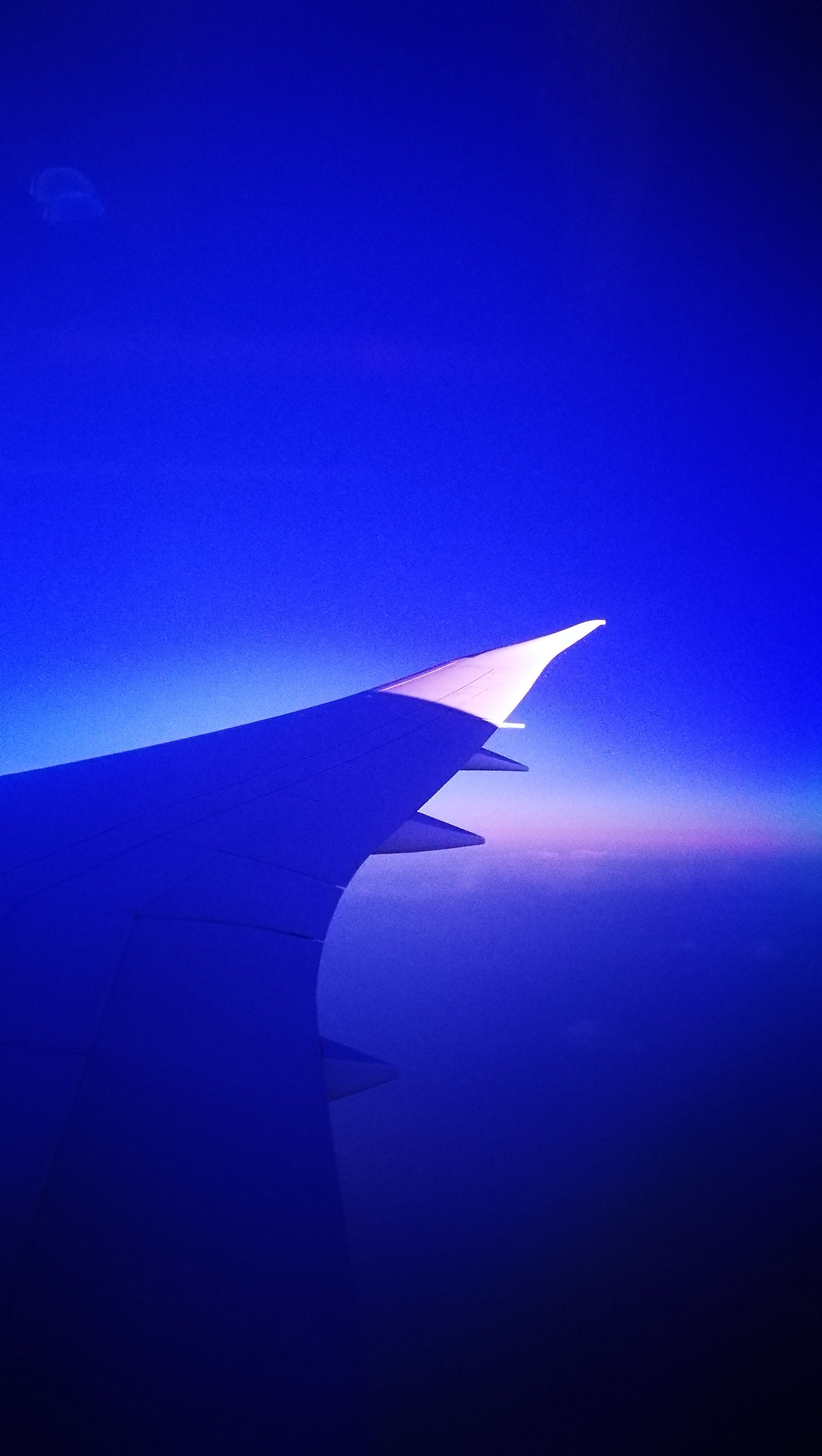sea, blue, part of, aircraft wing, cropped, transportation, water, tranquil scene, airplane, flying, mode of transport, aerial view, scenics, horizon over water, tranquility, beauty in nature, idyllic, clear sky, seascape, nature, air vehicle, sky, ocean, majestic, journey, outdoors, cloudscape, waterfront, airplane wing, no people