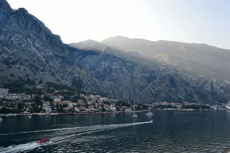First beams of the day Kotor Cattaro Montenegro Sea Dawn Beams Sun Morning Reflection Water Houses Fjord Fiordo Mattino Alba Raggi Sole Light Nature Mountains Boats Showacase August My Year My View Finding New Frontiers Miles Away
