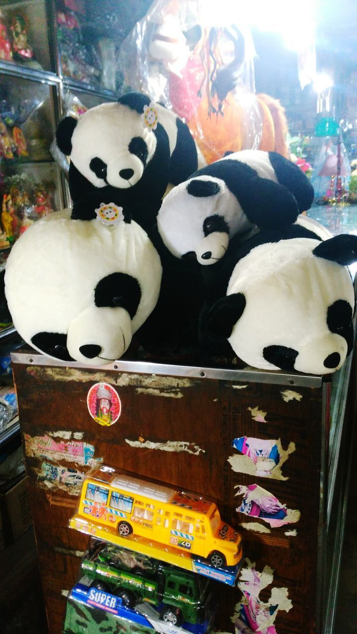 animal representation, art and craft, toy, retail, for sale, store, stuffed toy, no people, variation, multi colored, panda, teddy bear, choice, panda - animal, close-up, indoors, day