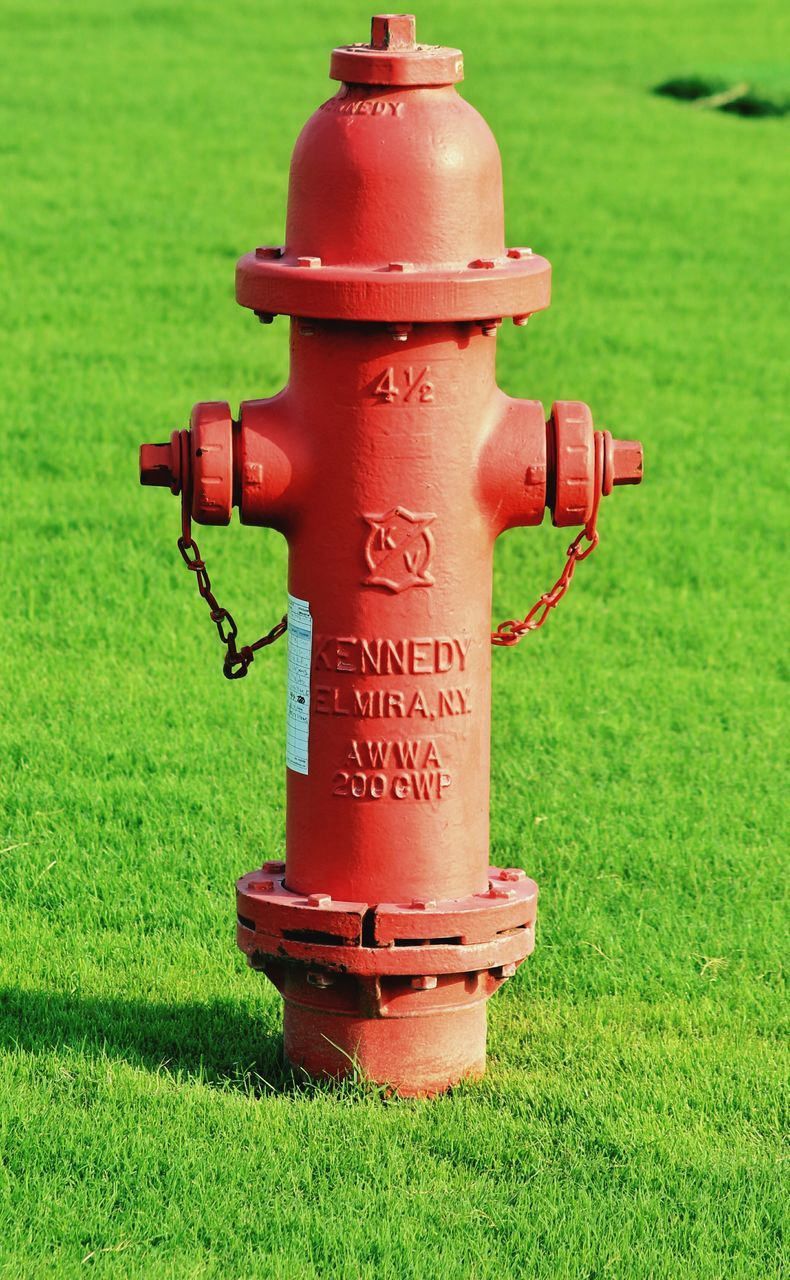 grass, green color, text, field, safety, day, red, no people, communication, outdoors, fire hydrant, close-up