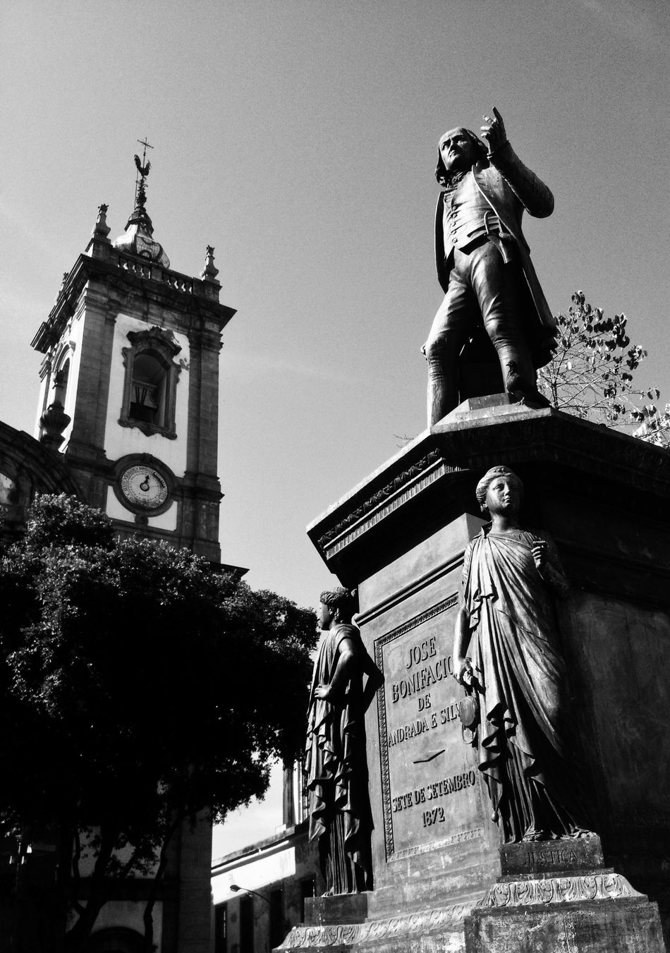 Streetphotography Blackandwhite Photography Rio De Janeiro IPhoneography Statue Human Representation Low Angle View Male Likeness Architecture Art And Craft Religion Built Structure Spirituality Place Of Worship Outdoors Building Exterior History Sky Day Travel Destinations Tree Clear Sky No People