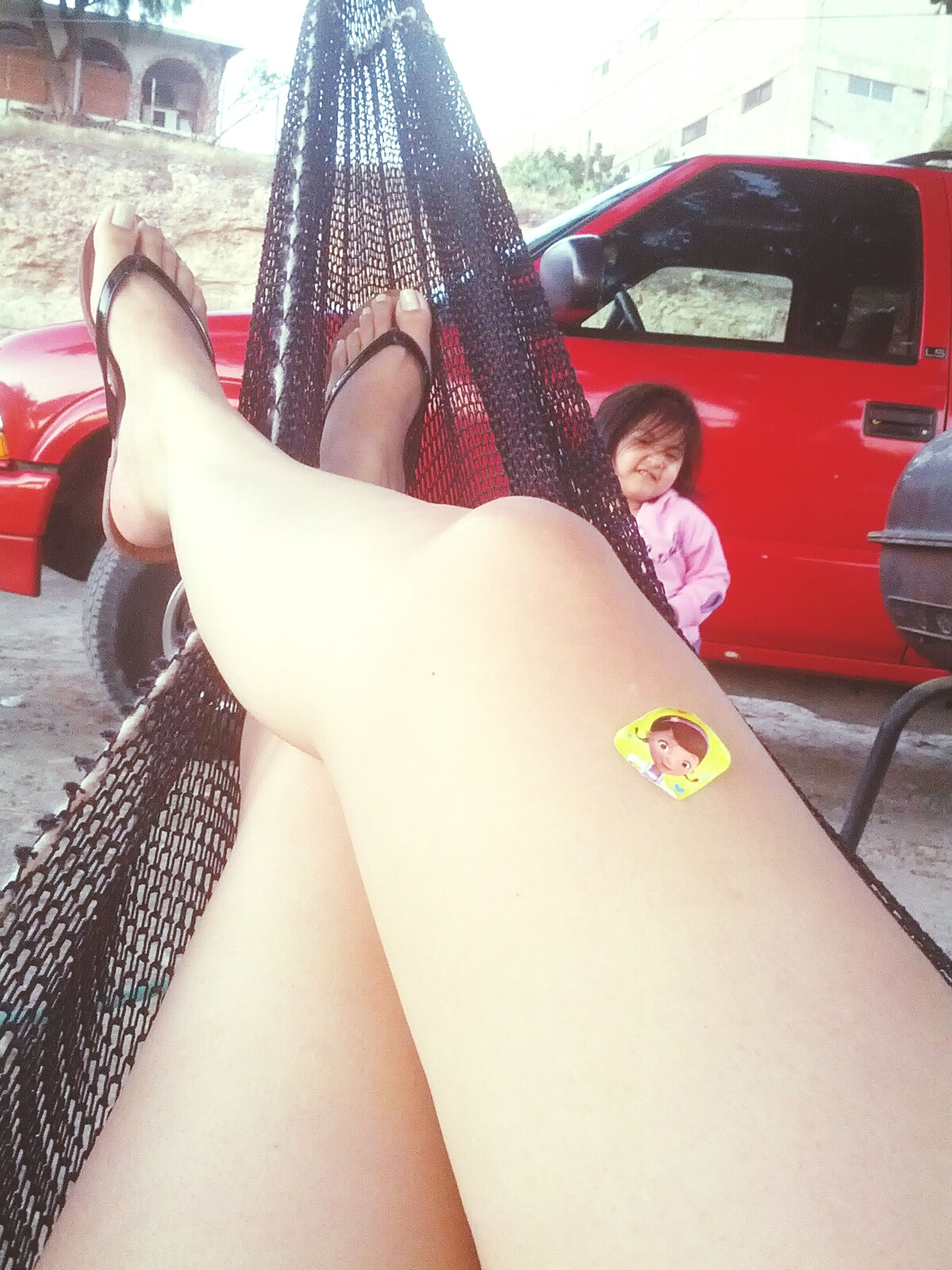 lifestyles, sitting, leisure activity, relaxation, low section, person, young women, young adult, casual clothing, lying down, resting, togetherness, relaxing, car, barefoot, legs crossed at ankle