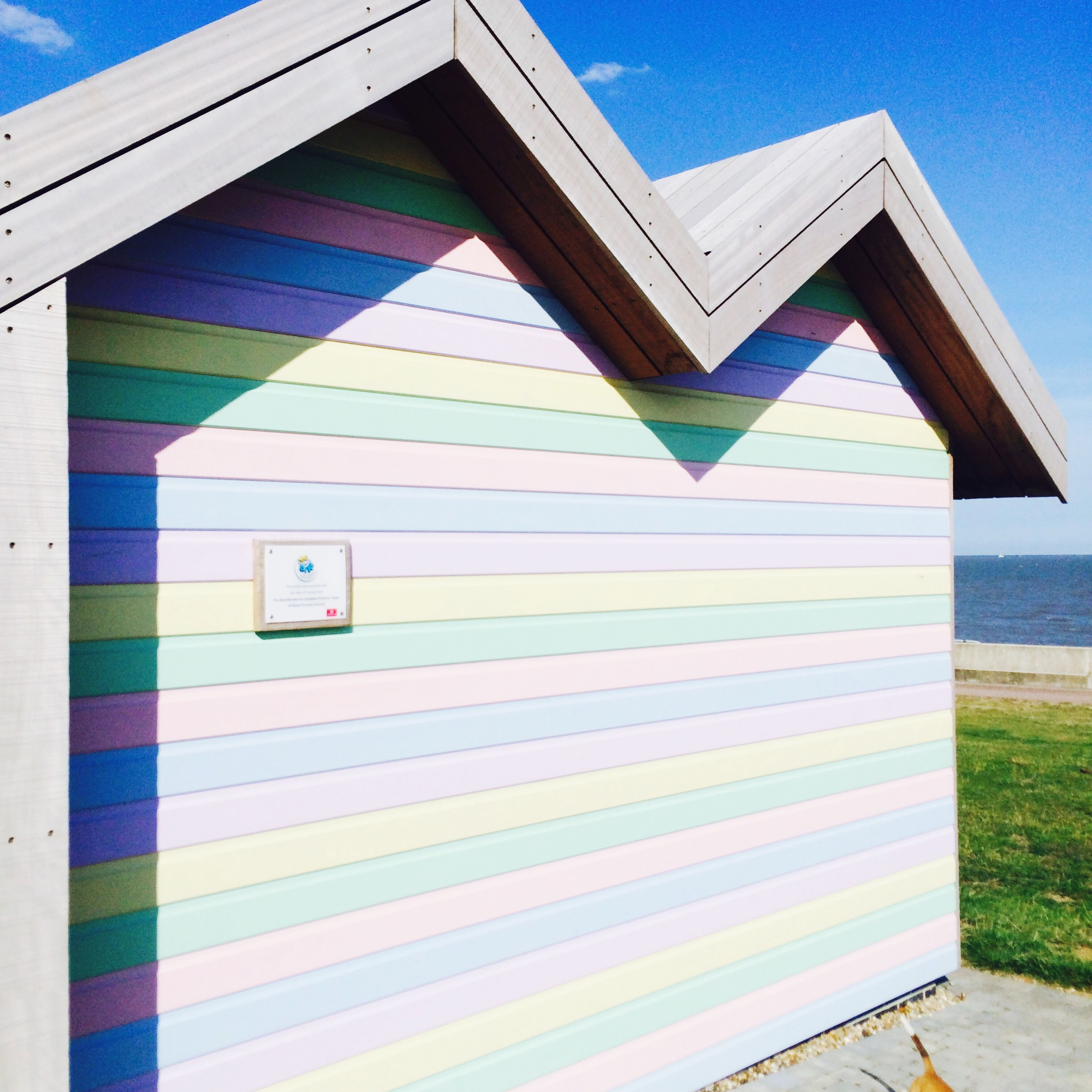 blue, built structure, architecture, building exterior, sunlight, shadow, clear sky, day, window, pattern, no people, sky, multi colored, outdoors, wall - building feature, striped, low angle view, sunny, wall, absence