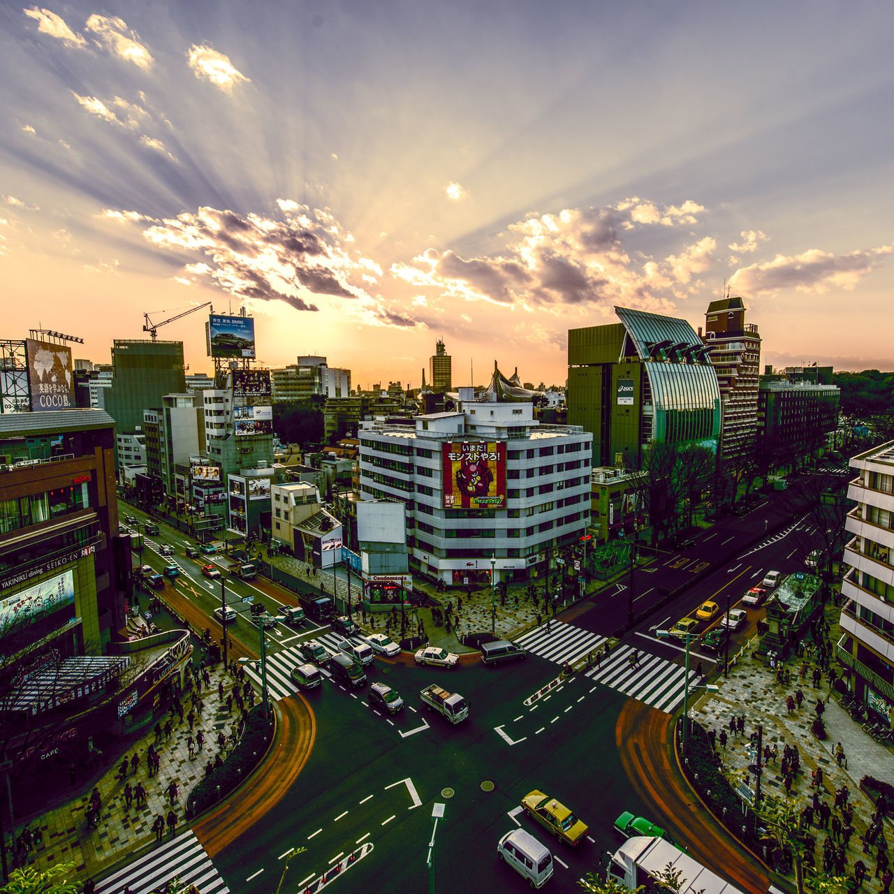 architecture, building exterior, cloud - sky, high angle view, city, built structure, cityscape, sky, city life, sunset, no people, skyscraper, outdoors, travel destinations, road, urban skyline, day, nature