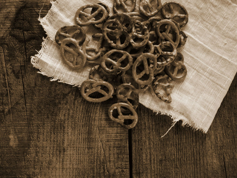 Heap of fresh Wheat salt pretzels on hessian linen fabric cloth and wooden table Circle Close-up Cloth Creativity Fabric Fresh Heap Hessian Linen Man Made Object No People Pretzels Salt Table Wheat Wooden
