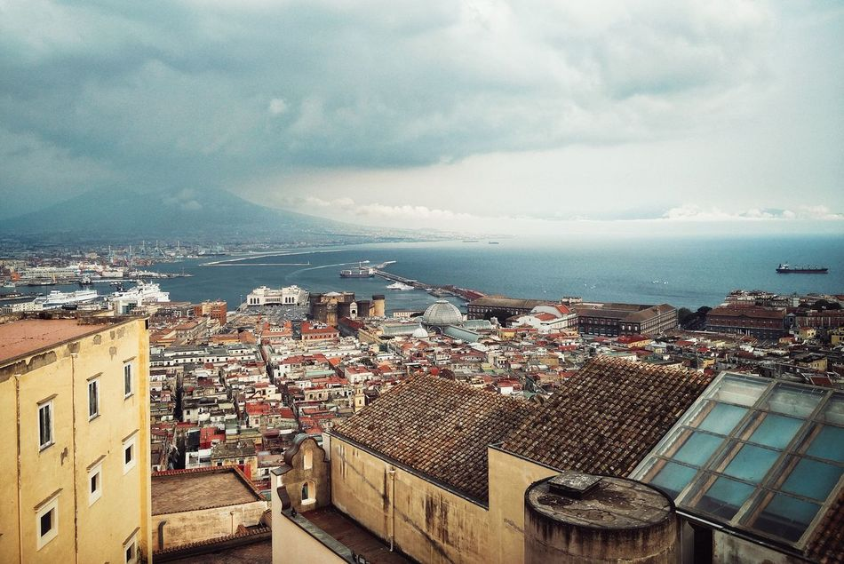 Guardando sul cielo Architecture Sky Built Structure City Cityscape Building Exterior Sea Travel Destinations Cloud - Sky Roof Outdoors No People Residential Building Storm Cloud Illuminated Nature Day Napoli ❤