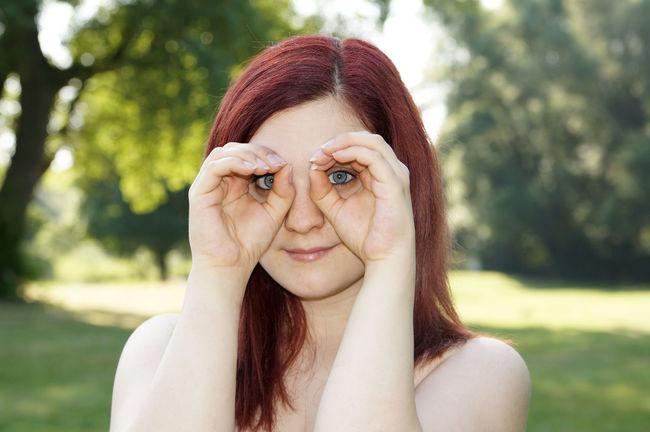 Binocular Female Fun Funny Girl Hands Leisure Looking Outdoor Peeking People Person Real People Silly Smiling Watching Woman