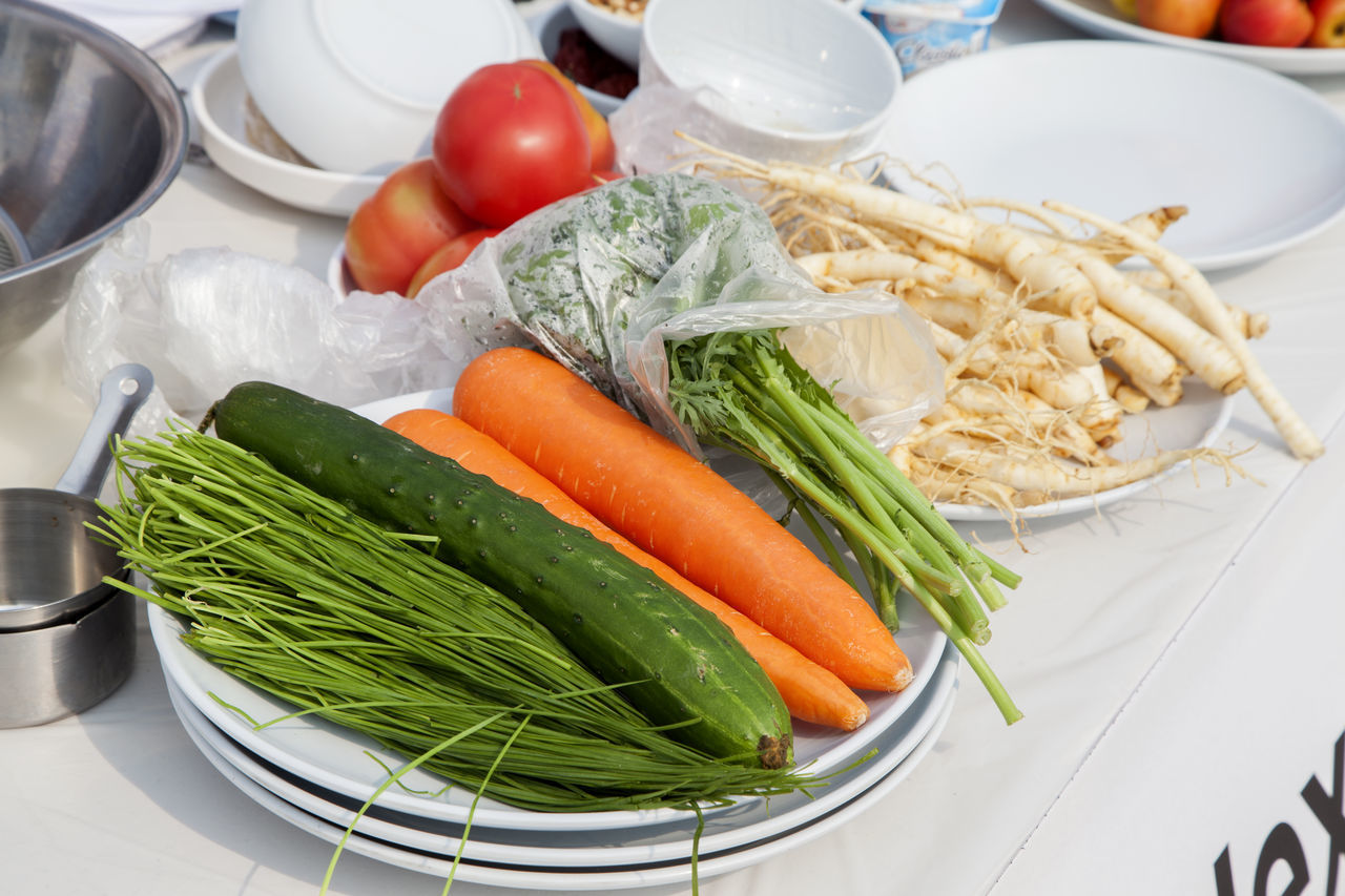 preparing for cooking Carrot Close-up Day Dish Food Food And Drink Freshness Ginseng Green Onion Healthy Eating Horizontal Indoors  No People Table Tomato Vegetable