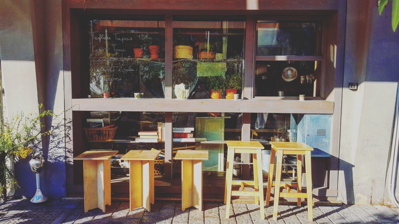 indoors, potted plant, table, no people, wood - material, day, shelf, chair, window, cafe