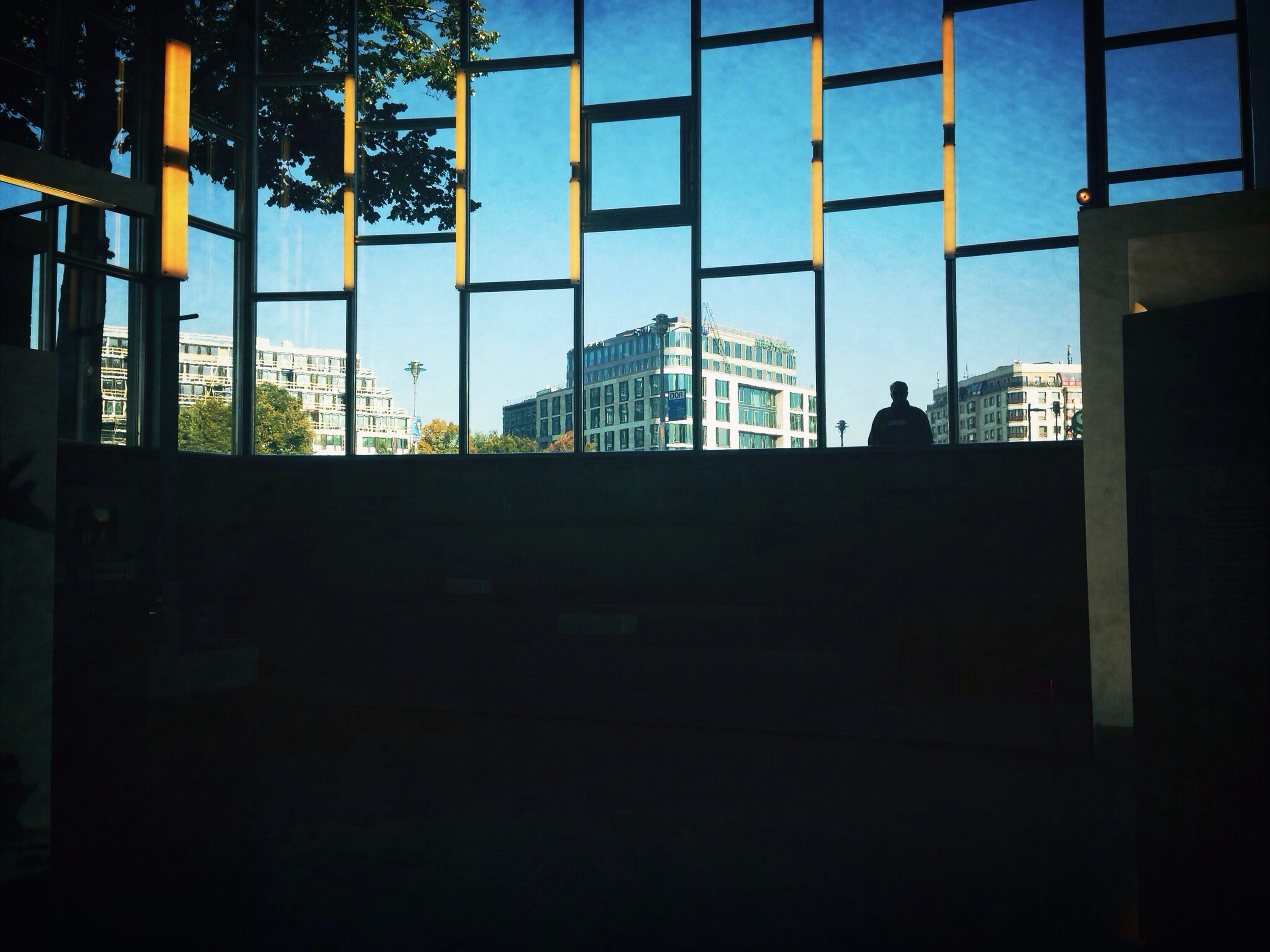 architecture, building exterior, built structure, silhouette, window, city, building, glass - material, residential building, sky, city life, residential structure, clear sky, sunlight, shadow, dark, office building, day, modern