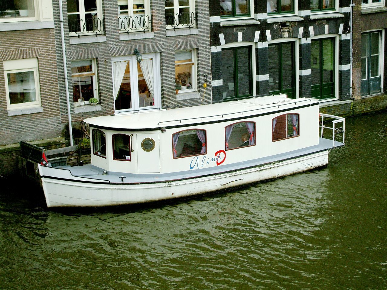 Your Amsterdam Alina D Person in a WhiteBoat Amsterdam Scene Amsterdam Canal Parking Boat EyeEm Gallery The Week On Eyem Popular Check This Out Street Photography Streetphotography