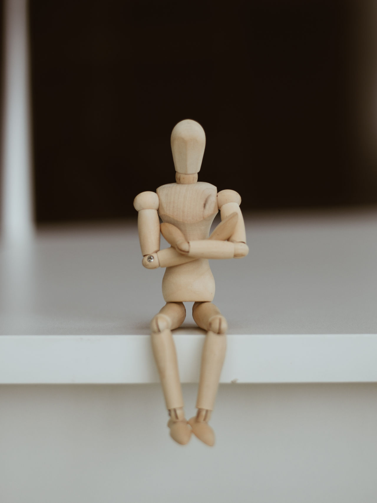 Wooden Man - Lonely figure sitting alone Alone Background Close-up Day Figurine  Human Representation Indoors  No People Surreal Wood - Material Wooden