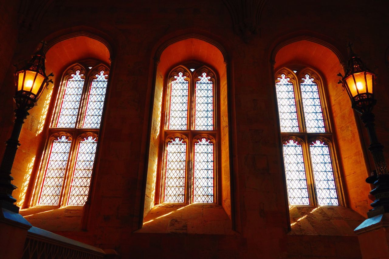 window, indoors, place of worship, low angle view, religion, day, spirituality, no people, architecture, built structure, close-up