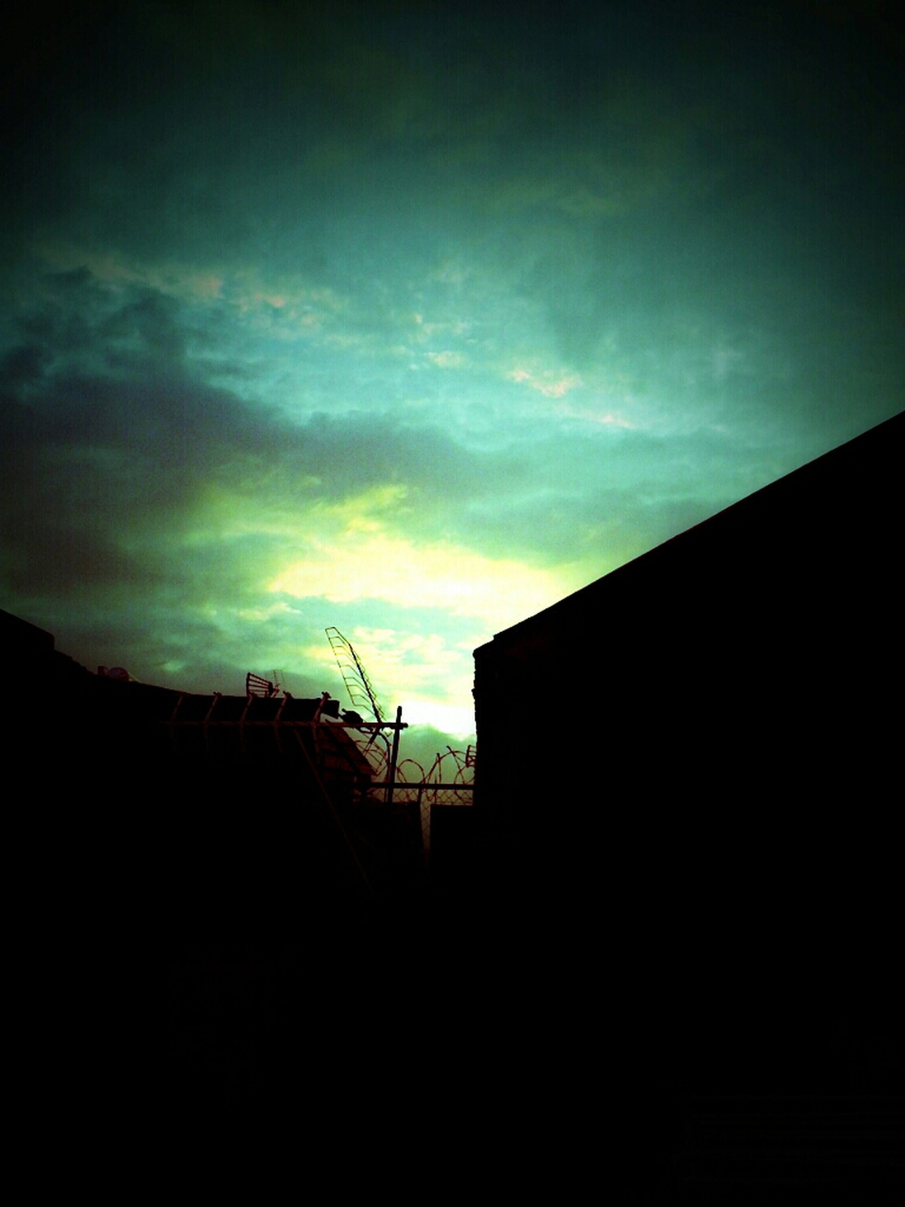 building exterior, architecture, built structure, sky, silhouette, house, sunset, low angle view, cloud - sky, residential structure, cloud, dusk, building, residential building, dark, outdoors, cloudy, no people, nature, copy space