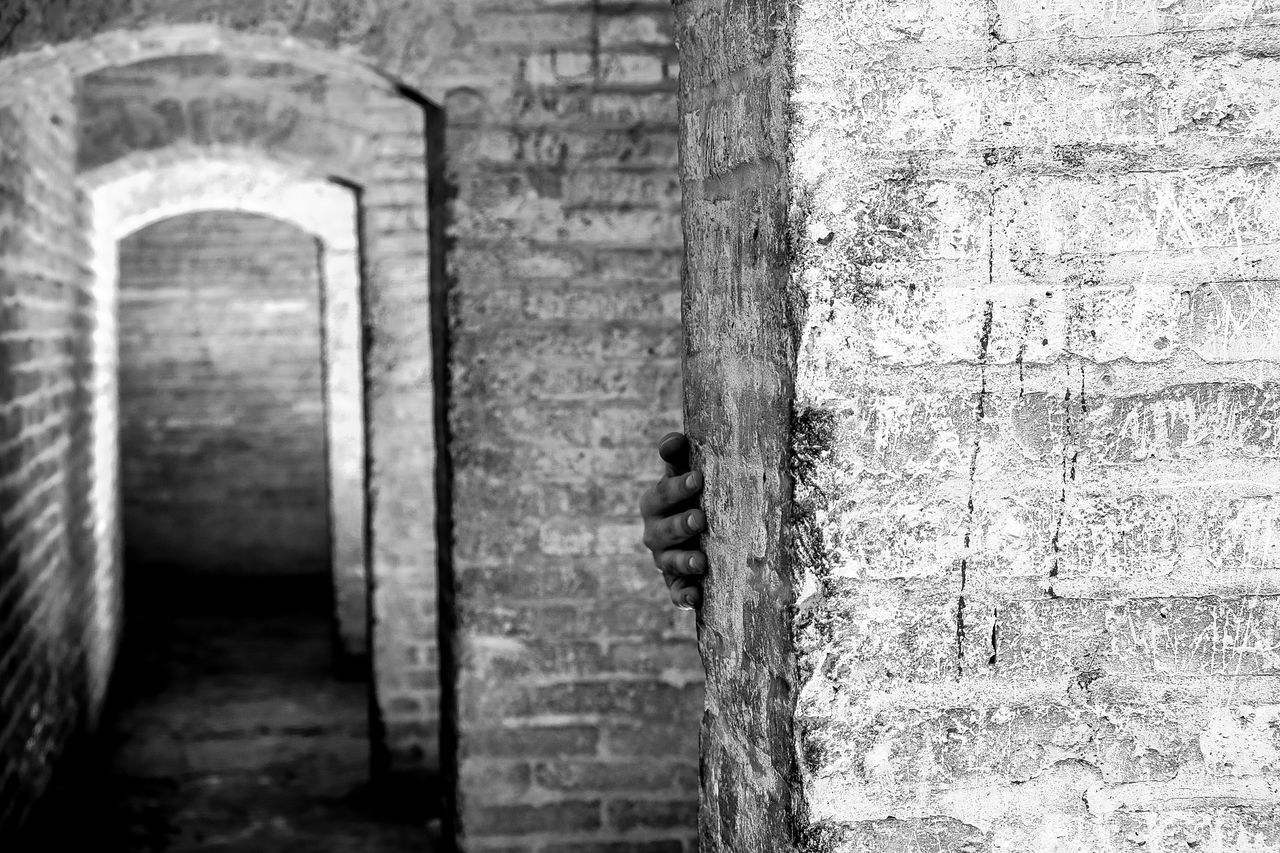 I've caught him! Hand Fingers Black And White Streetphotography Photography Architecture Coridor Wall Hidden Check This Out Street Photography Isfahan Fujifilm Urban Brick Pattern Texture Light And Shadow Brick Wall Old Building  Break The Mold Focus Object Let's Go. Together. The Street Photographer - 2017 EyeEm Awards The Architect - 2017 EyeEm Awards BYOPaper!
