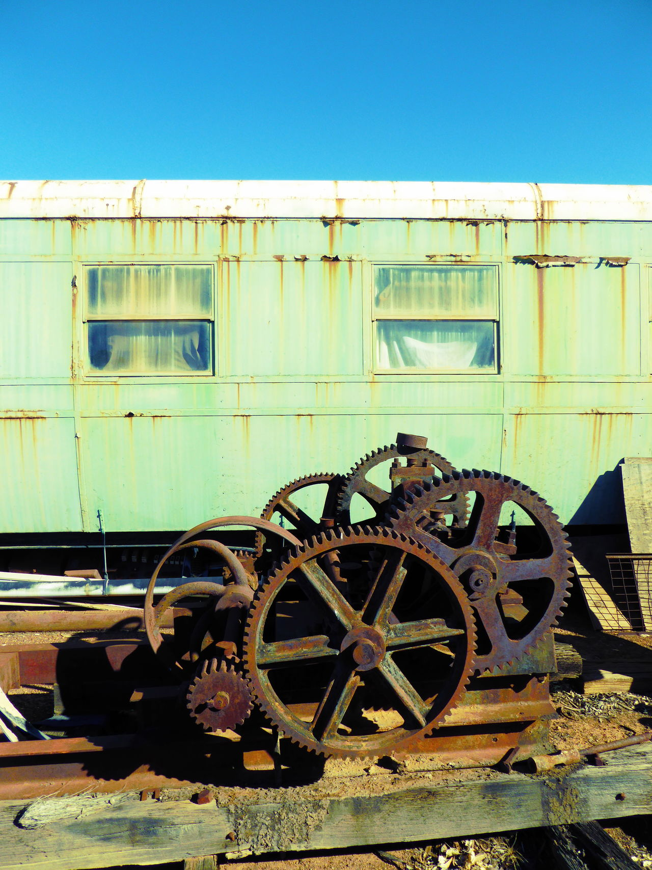 Abandoned Clear Sky Damaged Day Derelict Railway Carrige Junk Sculptures Junkyard Metal Junk Mode Of Transport No People Obsolete Old Railway Carriage Old-fashioned Outdoors Rail Transportation Railways Rusty Metal Rusty Metal Junk Sky Train - Vehicle Transportation Weathered Wheels