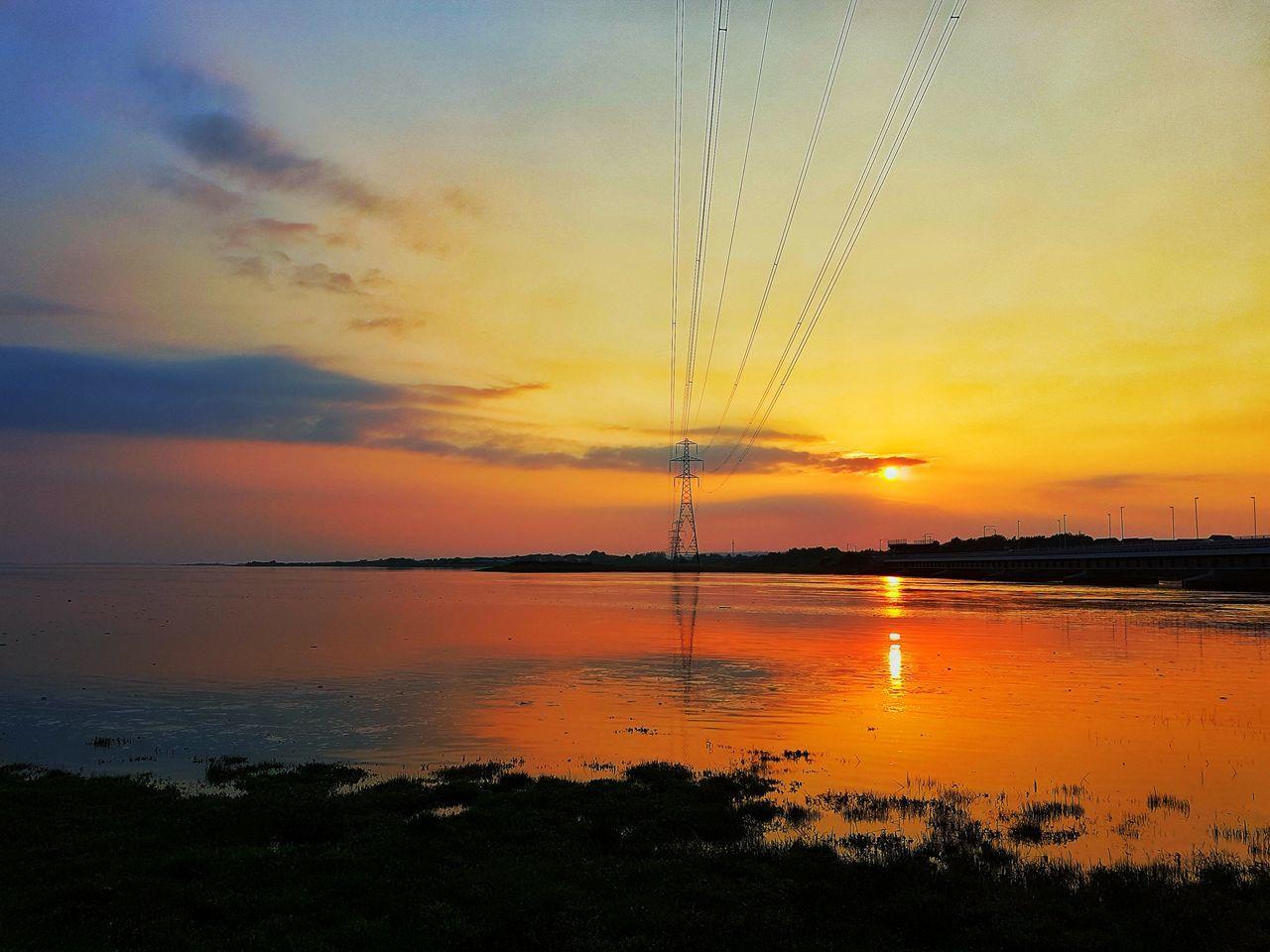 Sunset Water Scenics Tranquil Scene Reflection Orange Color Tranquility Idyllic Sky Beauty In Nature Nature Majestic Calm Cloud Cloud - Sky Sun Non-urban Scene Power Line  Coastline Sea