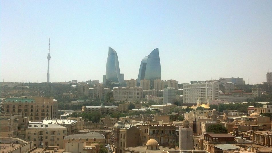 Flame Towers from Maiden Tower. Baku, Azerbaijan. Cityscape Skyscraper Travel Destinations Urban Skyline Architecture Outdoors Building Exterior No People City Sky Day Baku Azerbaijan Baku Azeri Azerbaijan Flame Towers Famous Place Maiden Tower