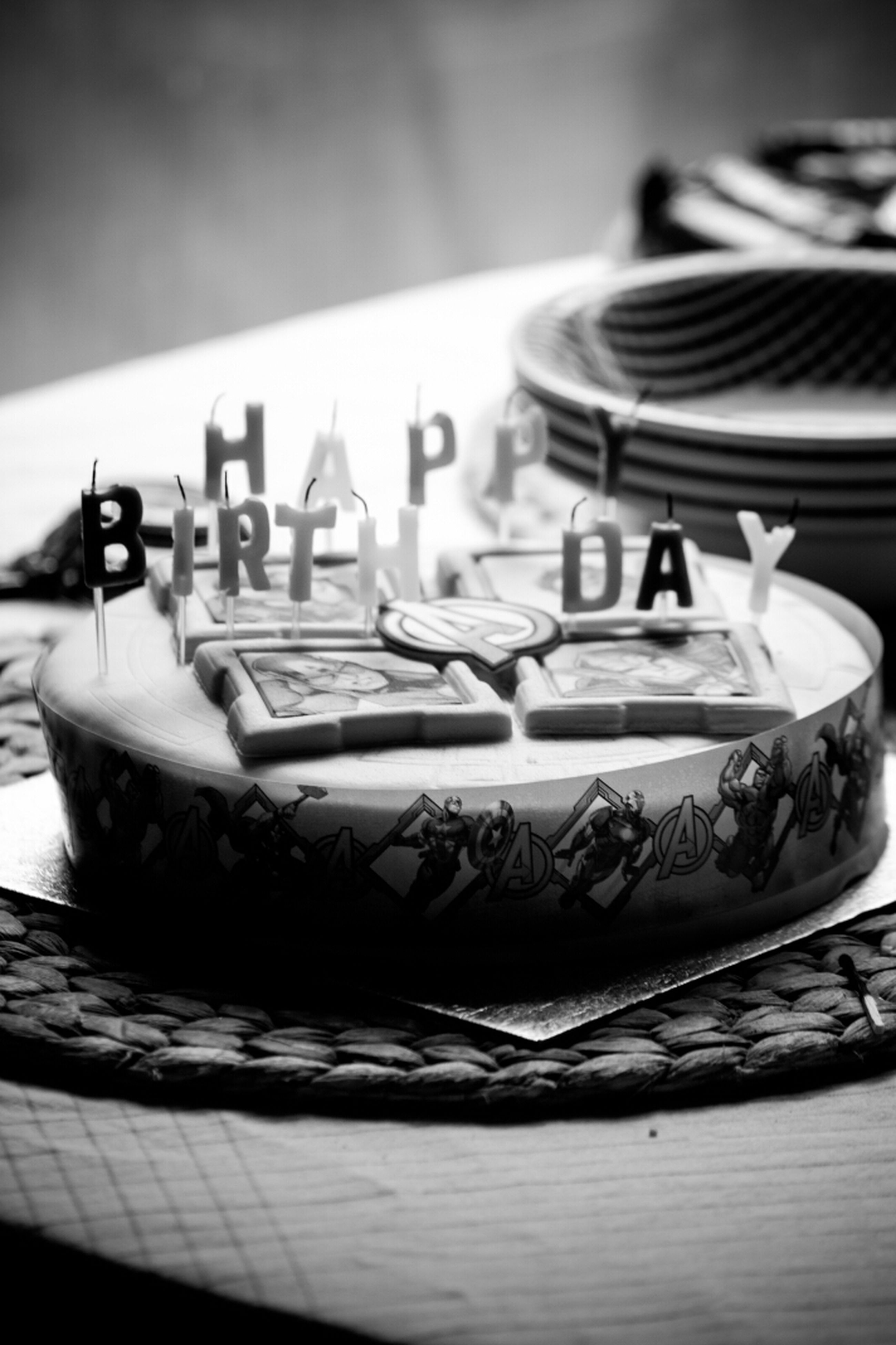 indoors, table, focus on foreground, close-up, still life, selective focus, absence, wood - material, no people, art and craft, day, creativity, home interior, text, in a row, art, empty, paper, pattern, cake
