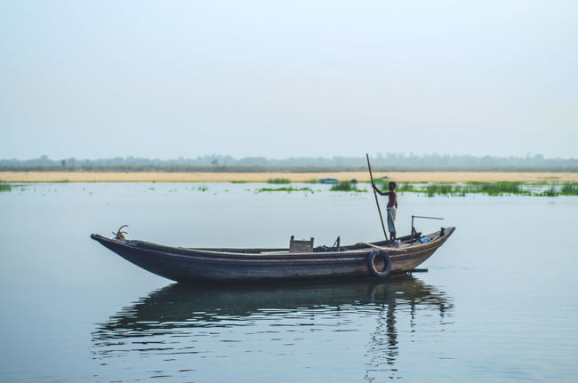 The River and The Boat Beauty In Nature Boat Calm Day Idyllic Lake Mode Of Transport Nature Nautical Vessel No People Non Urban Scene Non-urban Scene Outdoors Remote Rippled Scenics Sky Tranquil Scene Tranquility Water On The Go  Showcase July Hidden Gems