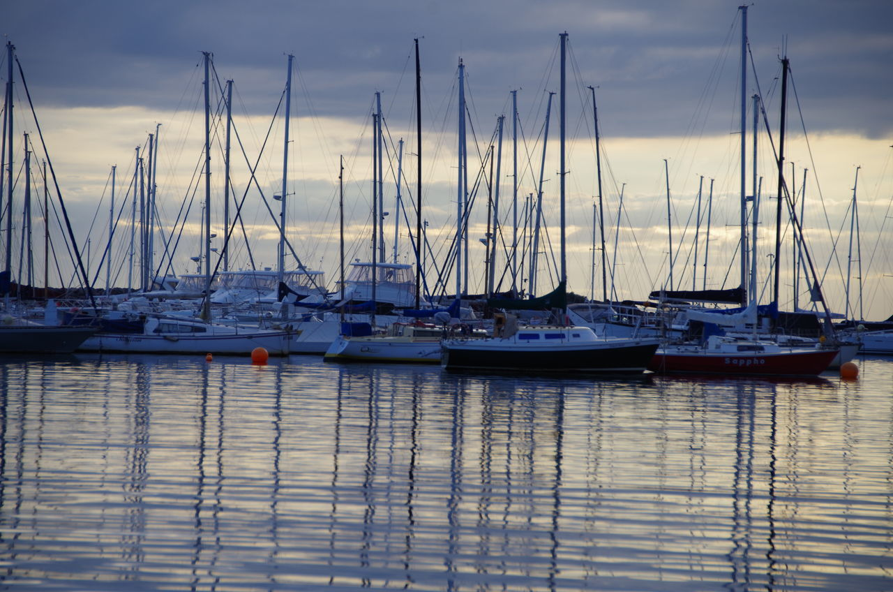 nautical vessel, moored, no people, water, transportation, mast, mode of transport, sky, outdoors, reflection, cloud - sky, nature, sailboat, tranquility, day, harbor, beauty in nature
