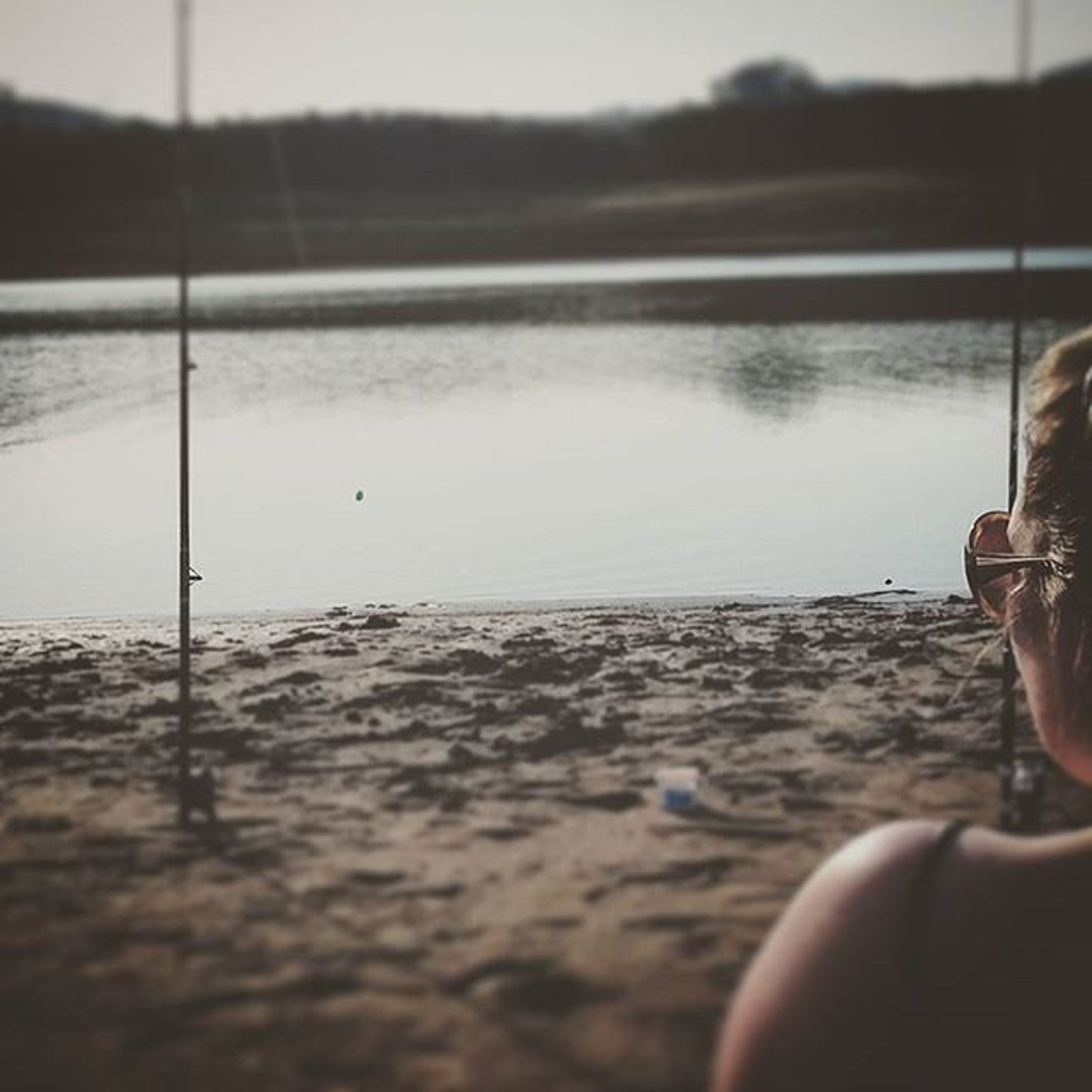 lifestyles, part of, leisure activity, water, focus on foreground, cropped, person, selective focus, men, low section, unrecognizable person, lake, personal perspective, reflection, close-up, nature