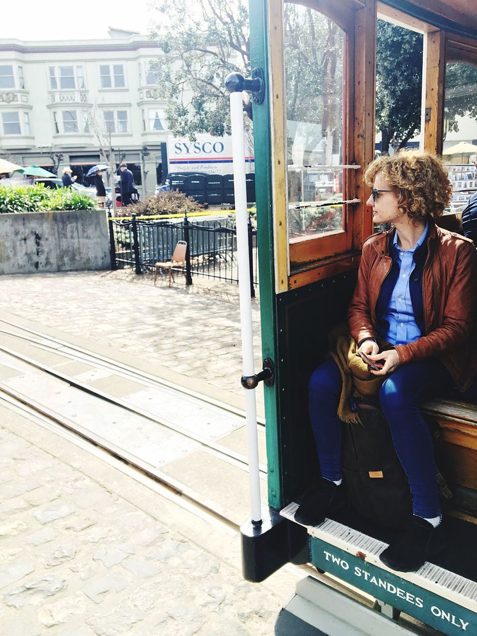 IPhoneography Iphonephotography IPhone Photography Tram Curly Hair Girl Full Length One Person Sitting Day Lifestyles Real People Outdoors Young Adult Architecture One Man Only City Adult Adults Only People