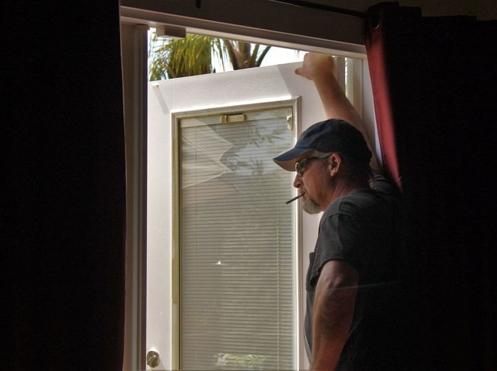 Badboy California Love Cigarette Time Cigarettes Eye4photography  Home Interior Indoors  Interior Interior Views Lifestyles Palm Trees Person Reflection In The Window Standing Sunday Afternoon Sunglasses Thinking Thinking About Life Waist Up