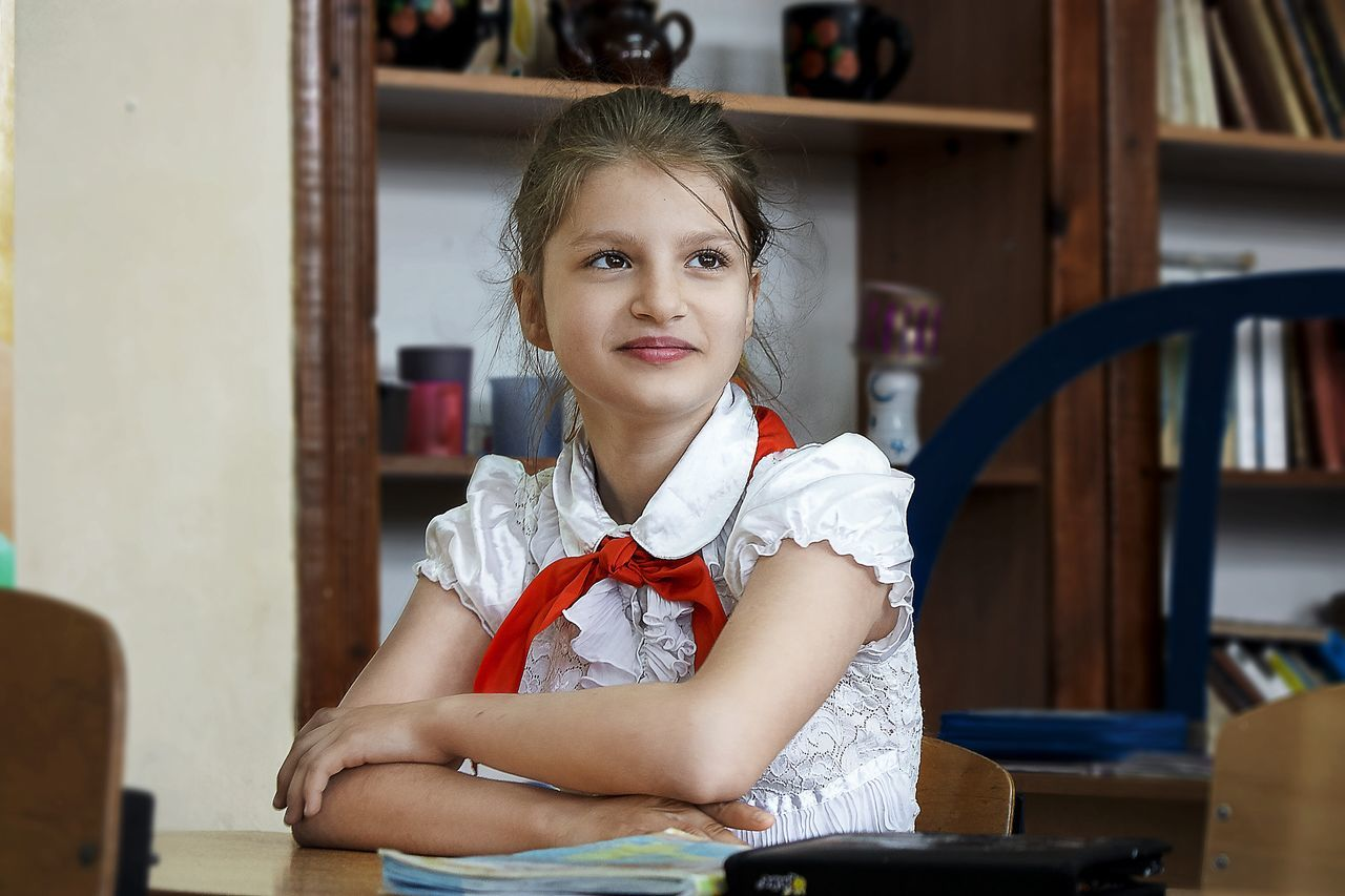 Today on one pioneer there was more Russia Portrait Childhood Looking At Camera Indoors  Front View One Person Girls Blond Hair Child Casual Clothing Elementary Age Home Interior Sitting Real People Day Children Only People