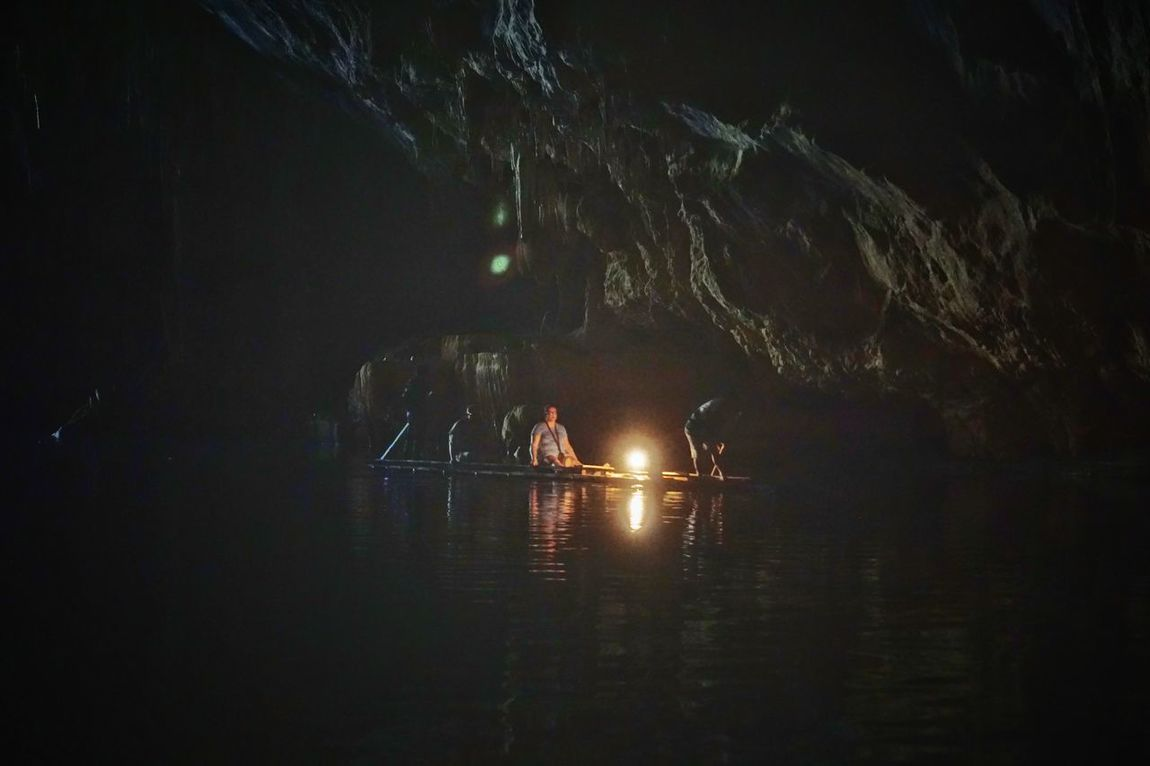 Light and darkness play best in caves. Reflection Water Scenics Nature Tranquility Travel Destinations Beauty In Nature Illuminated Real People Miles Away Beauty In Nature Cave Boat Bamboo Rafting Light And Shadow Thailand