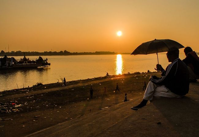People And Places Sunset_collection Streetphotography Riverview Eyeem Philippines Vibrant Color Watching The Sunset Silhouette Umbrella Man