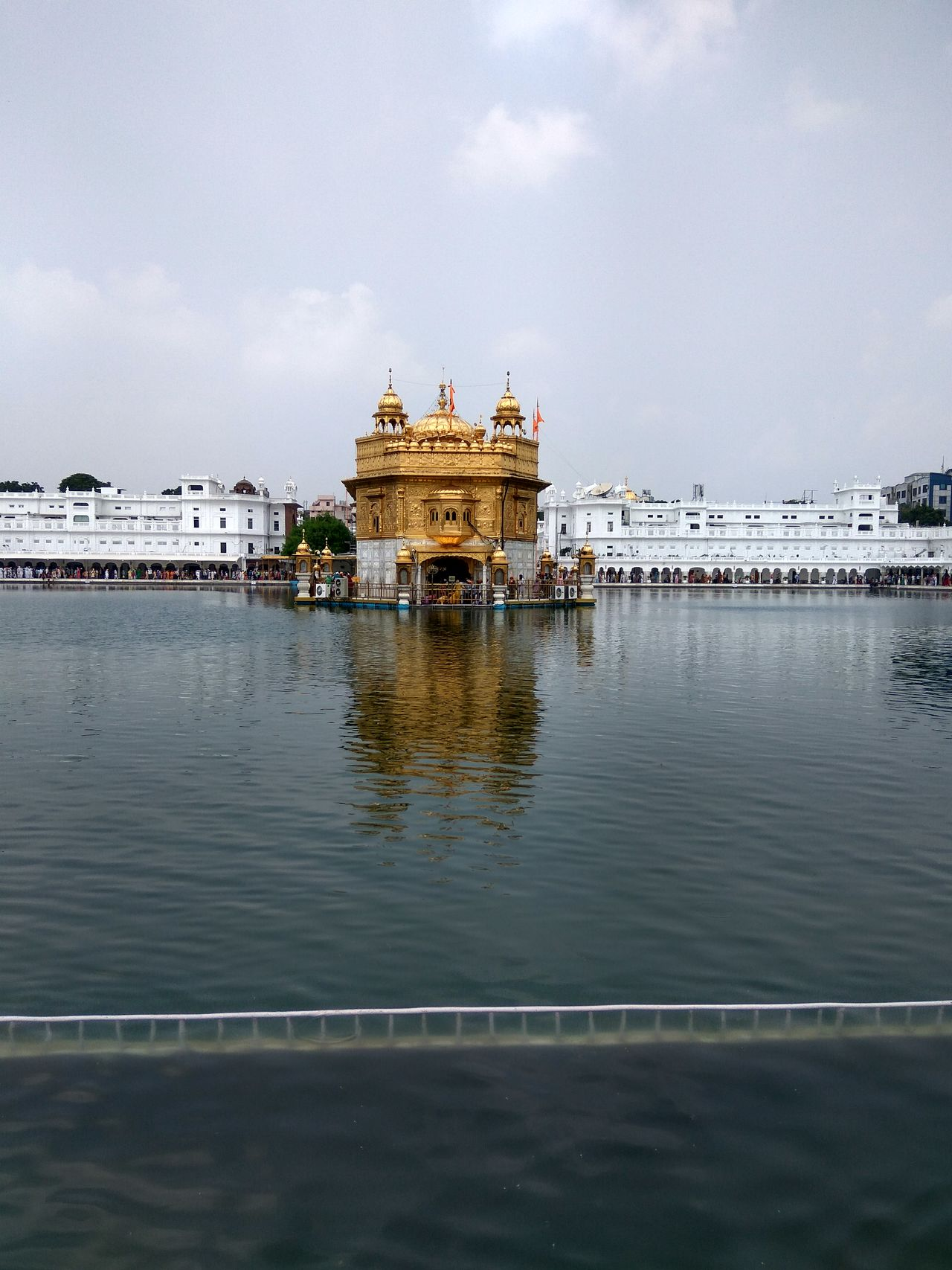 Golden Temple Golden Temple, Amritsar Reflection Water Architecture Travel Sky Cloud - Sky Government Politics And Government Gold Travel Destinations Built Structure Gold Colored Outdoors City Business Finance And Industry No People Royalty Nature Day