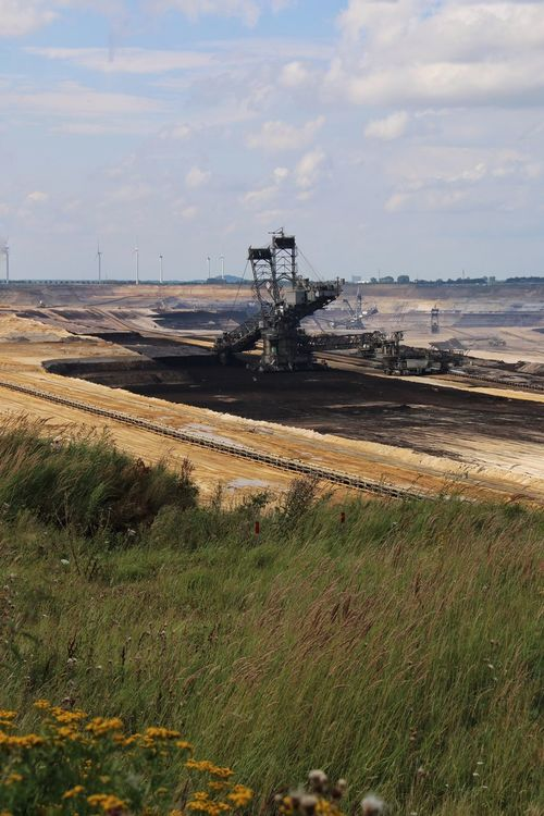 Brown coal surface mining - open cast coal mining. Huge bucket wheel excavator. new developed technology. Supposed to be more environmentally friendly. Bucket Wheel Excavator Cloud - Sky Development Field Grass Industry No People Non-urban Scene Open Cast Coal Mining Outdoors