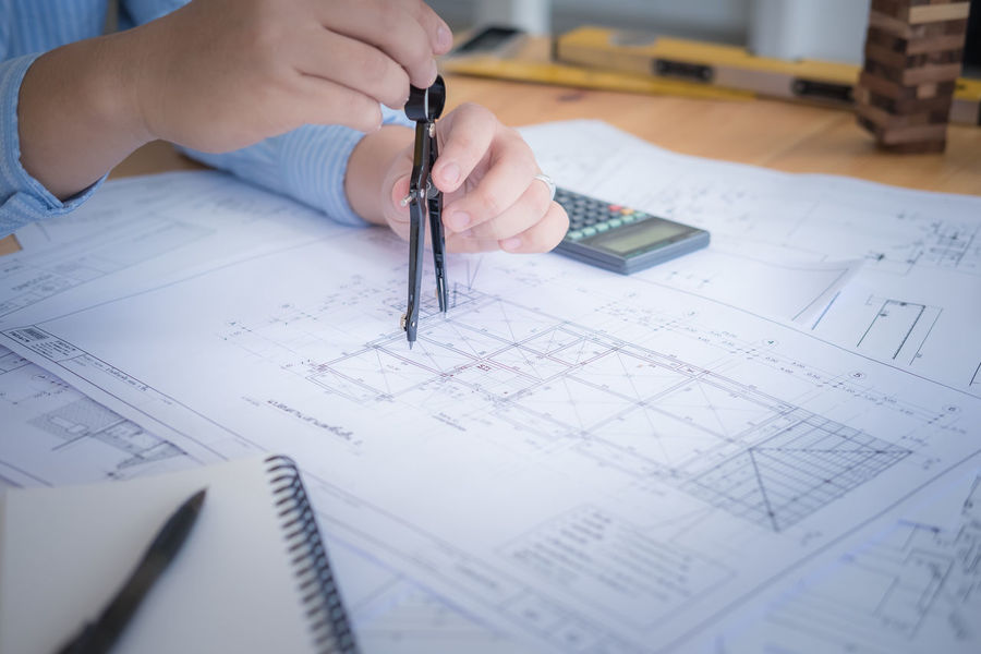 Blueprint eyeem architect or planner working on drawings for construction plans at a table architect architecture blueprint close malvernweather Image collections